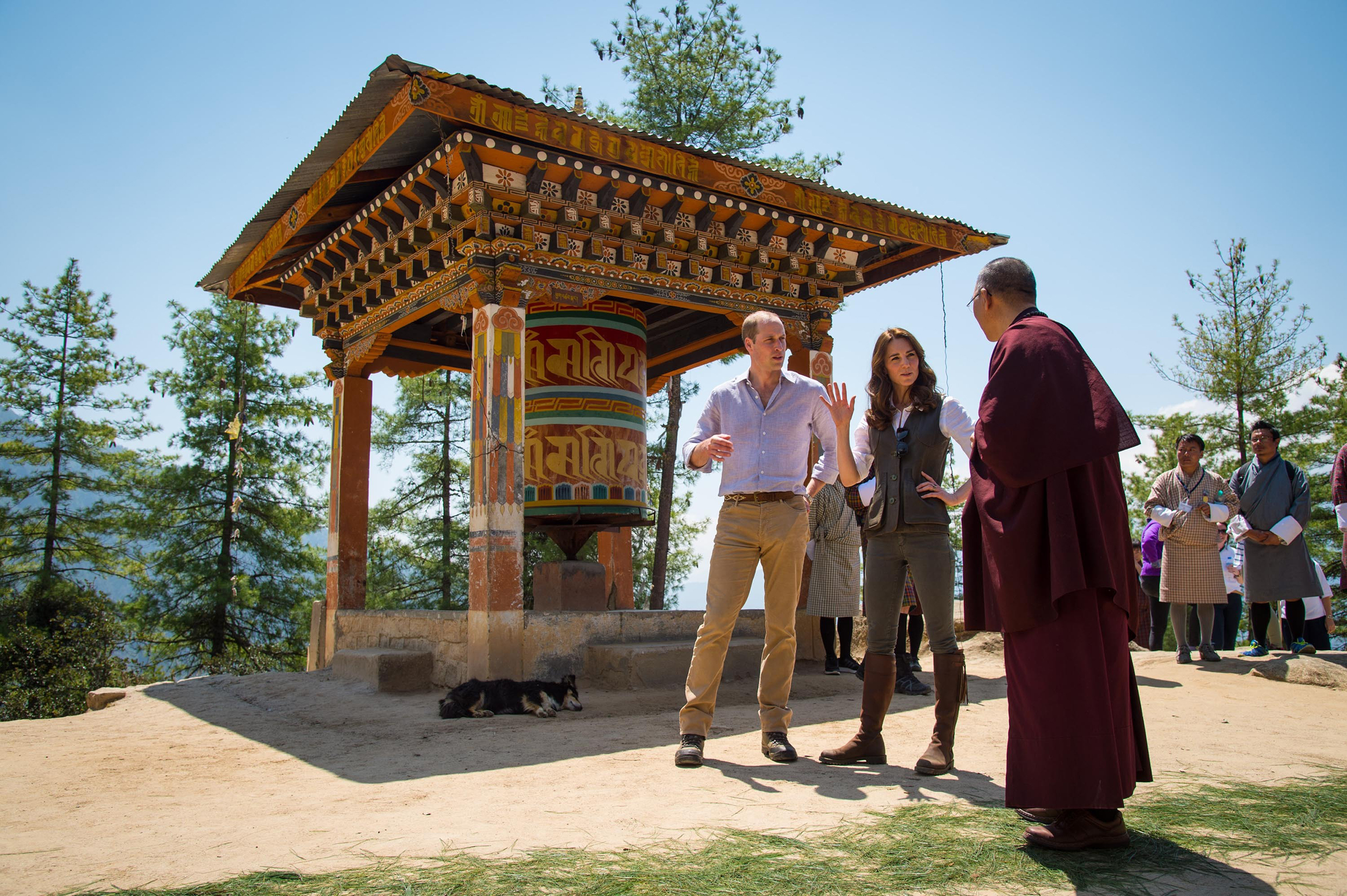 Prince William, Duke of Cambridge and Catherine, Duchess of Cambridge chat with a monk on the trek up to Tiger's Nest during a visit to Thimphu, Bhutan on April 15, 2016.