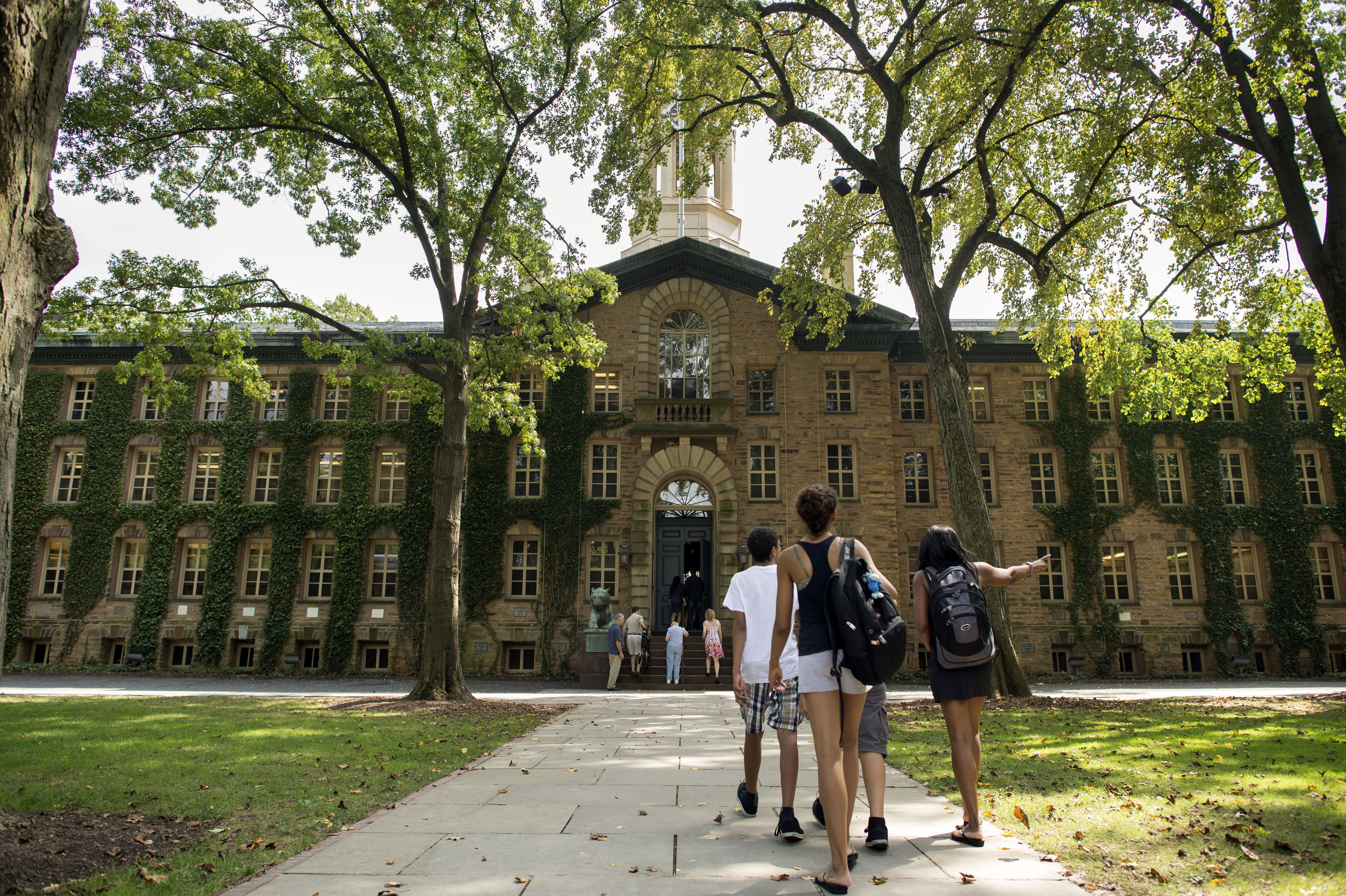 People walk on the Princeton University campus in Princeton, New Jersey, U.S., on Friday, Aug. 30, 2013.