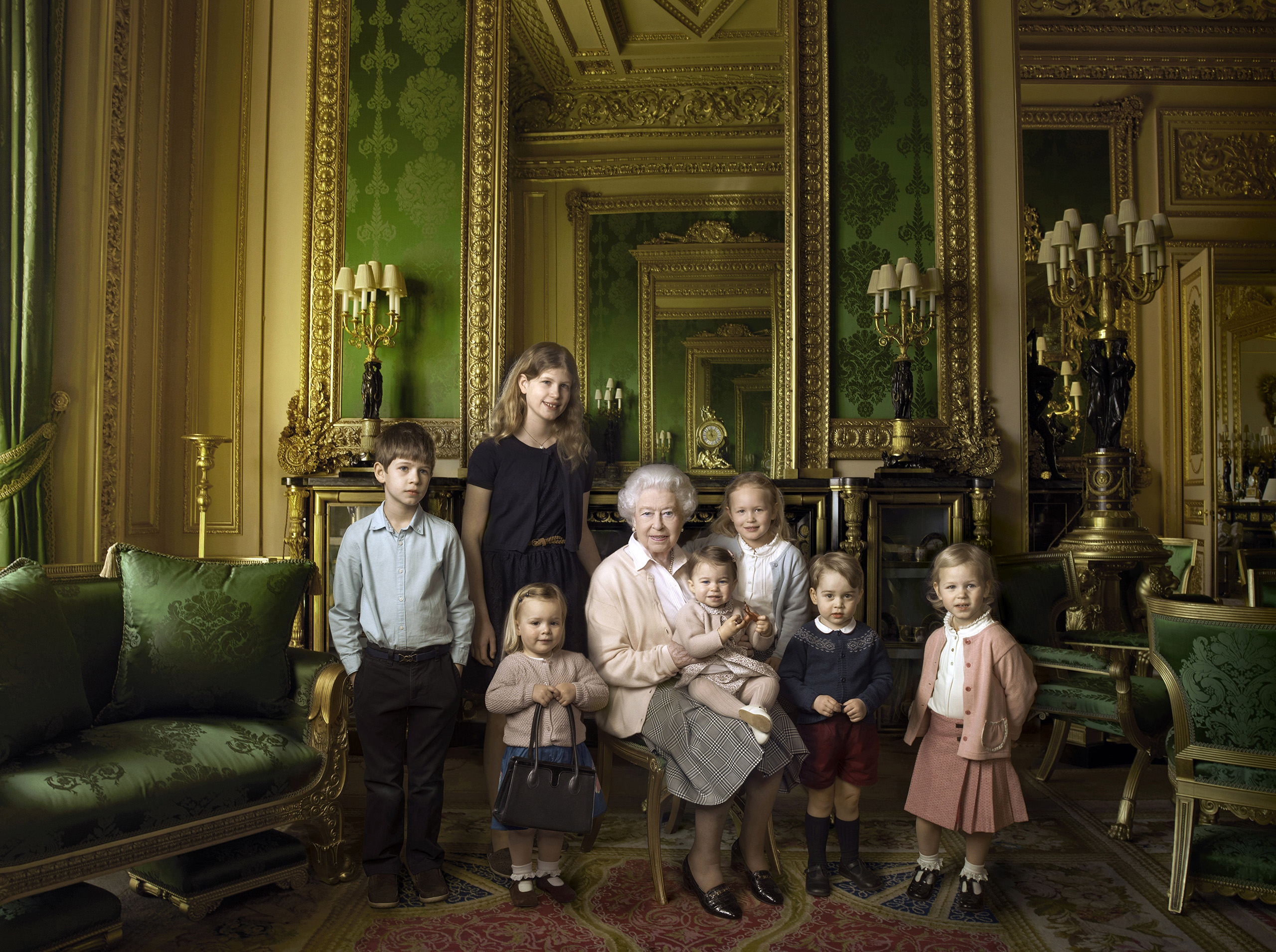 This official photograph released by Buckingham Palace to mark Queen Elizabeth II's 90th birthday shows her five great-grandchildren and her two youngest grandchildren in the Green Drawing Room, part of Windsor Castle's semi-State apartments, April 20, 2016.