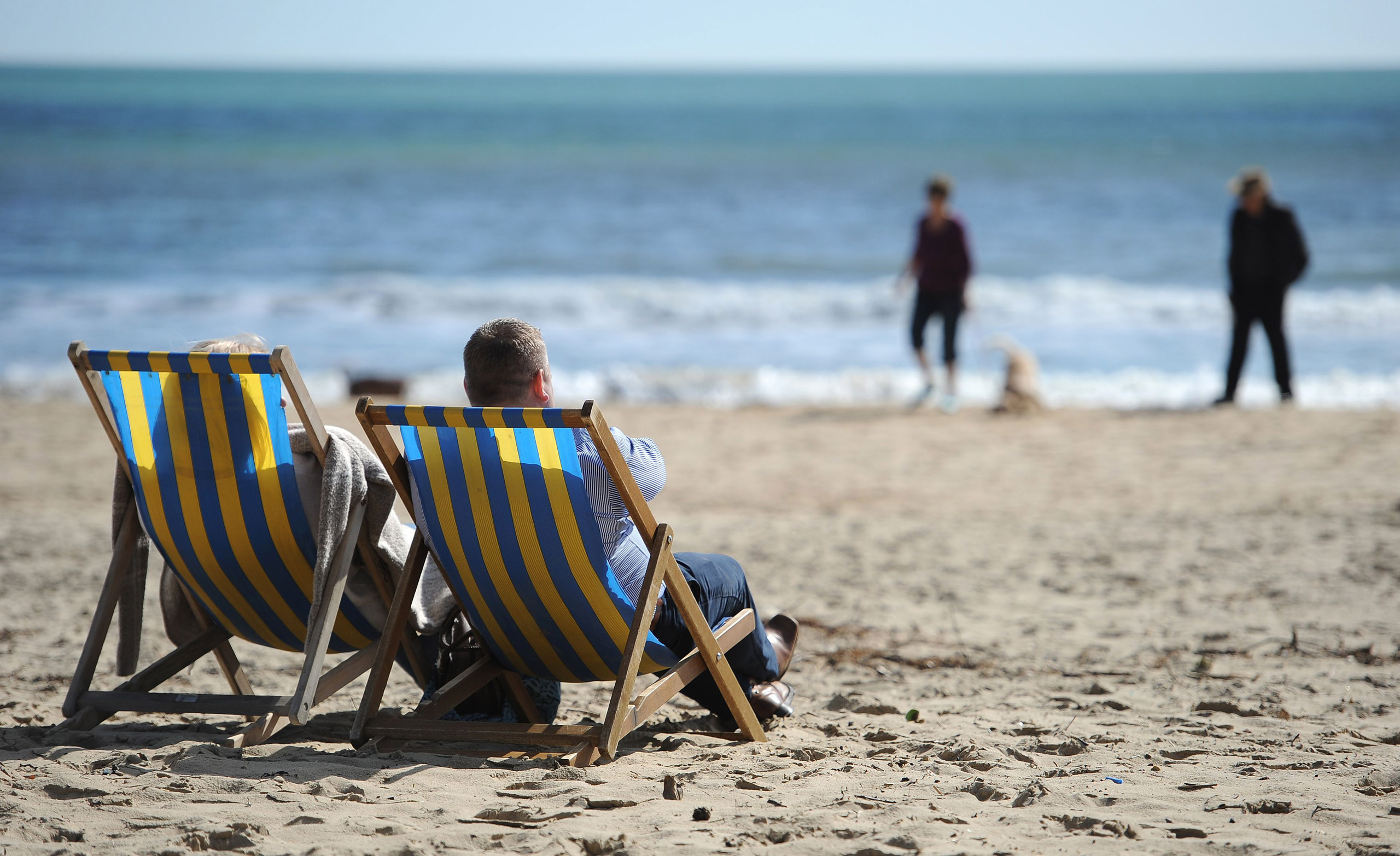 People enjoying the sun on Bournemouth beach, U.K., on Mar. 25, 2016.