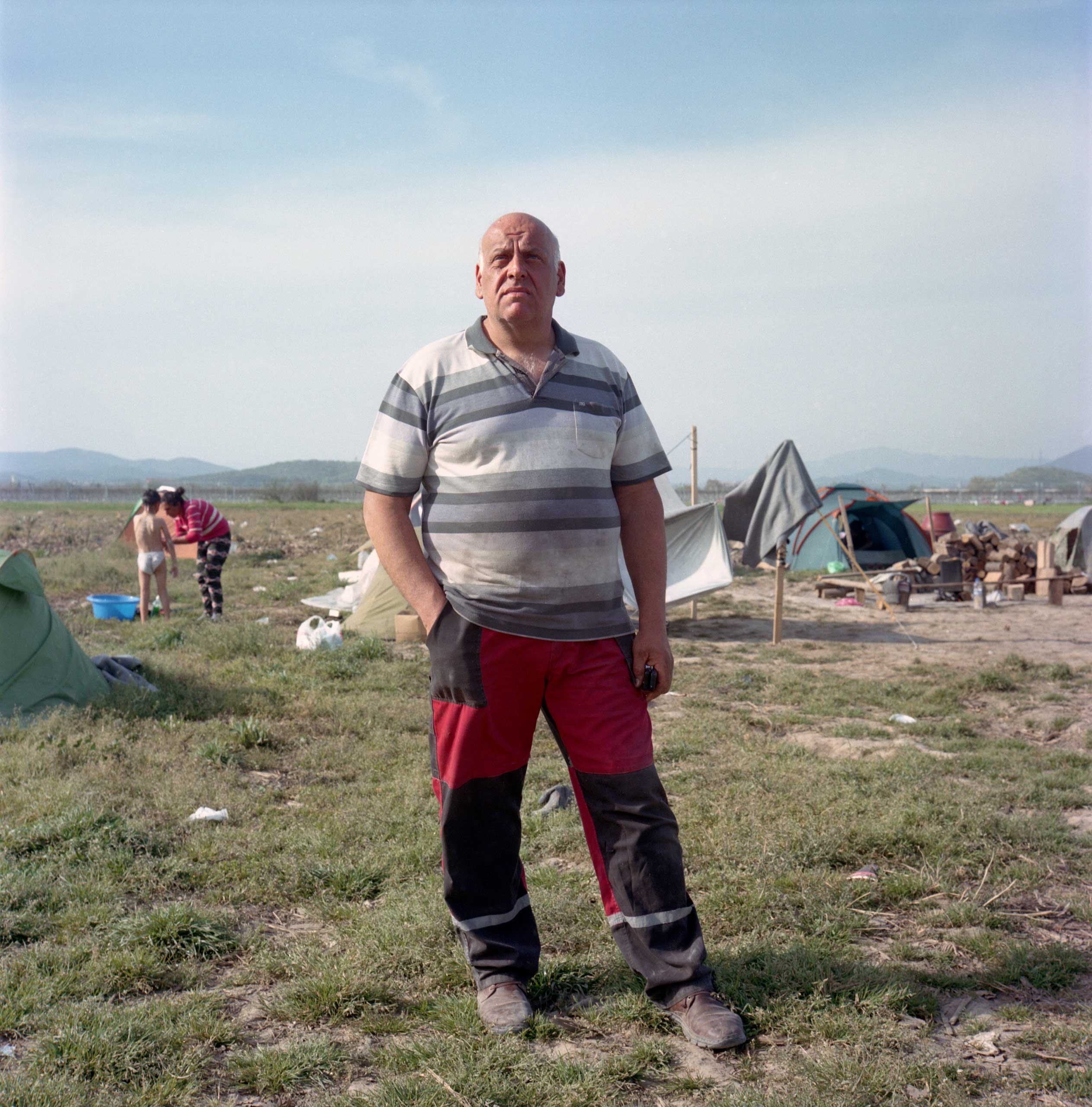 <b>Lazarous Oulis, a livestock farmer</b>                                   Lazaros Oulis stands in a field where he used to plant crops to grow animal feed. Since Sept. 2015, refugee tents have spread on nearly 250 acres of his land, all the way to the border with Macedonia, preventing him from working on his harvest and resulting in losses of 20,000 Euros. Idomeni, Greece. April, 2016