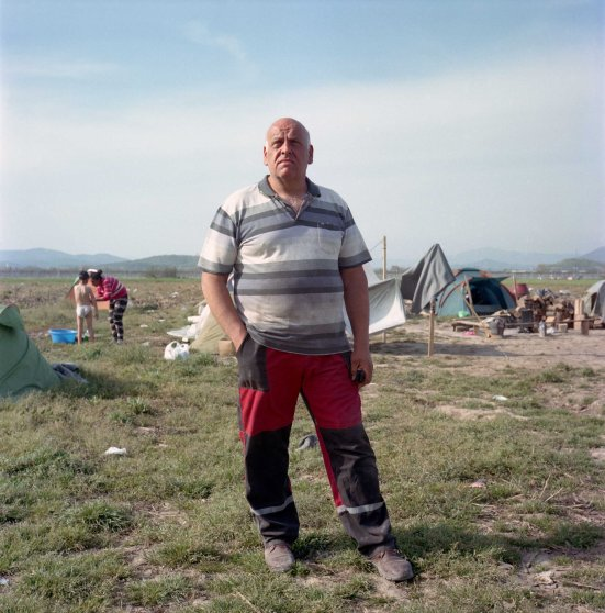 Lazarous Oulis, livestock farmer from Idomeni stands in a field where he planted crops to grow animal feed. Since September 2016, refugee tents have spread on nearly 250 acres of Lazaros Oulis'es land, all the way to the border with Macedonia, preventing him from working on his harvest and resulting in losses of Euro 20,000 for which he claims he had not received any compensation. Idomeni, Greece. April, 2016