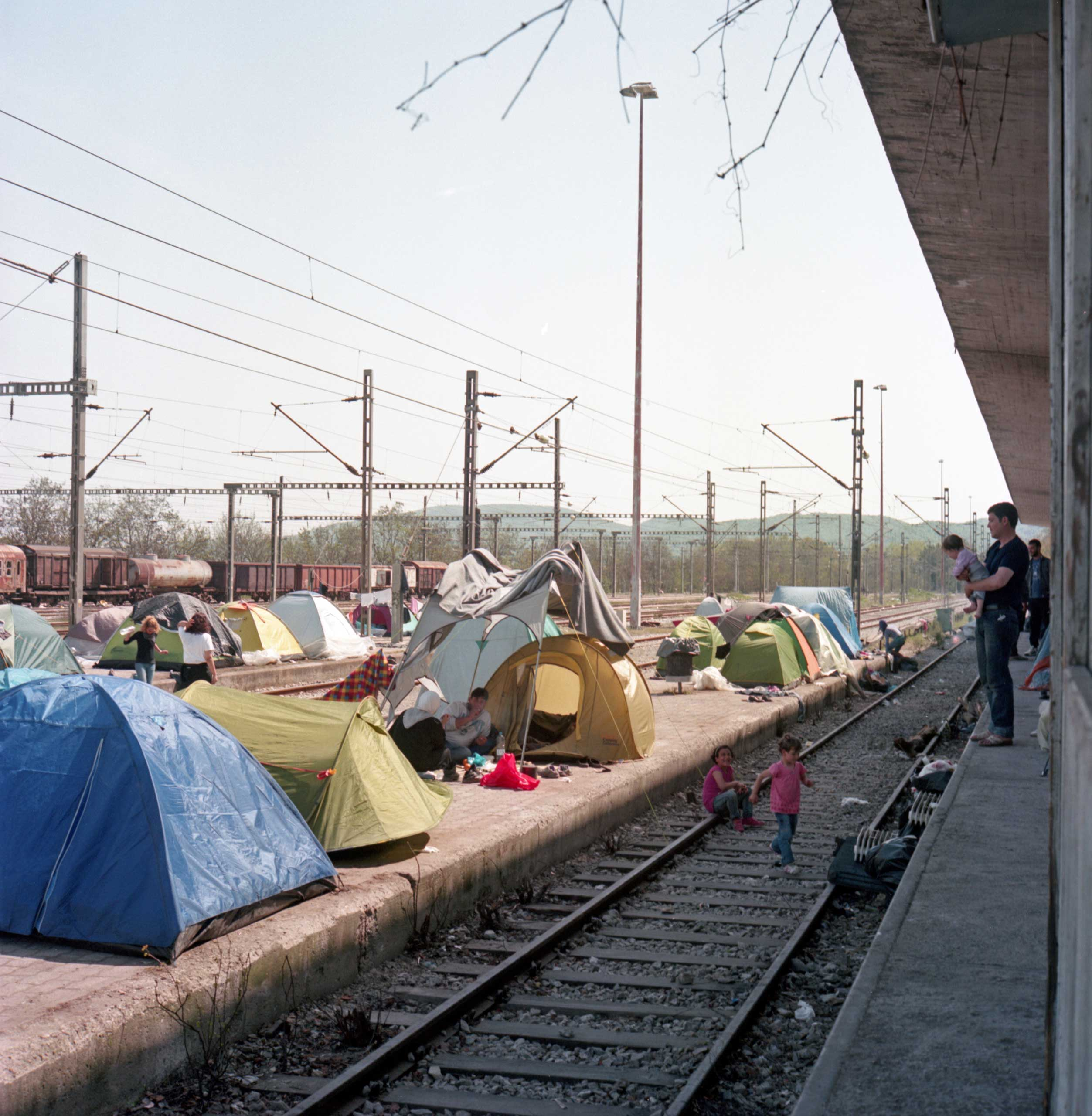 Refugee tents have spread to the village's railway platforms. Idomeni, Greece. April 2016.
