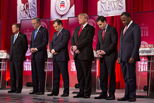 2016 Republican Presidential candidates John Kasich, governor of Ohio, from left, Jeb Bush, former governor of Florida, Senator Ted Cruz, a Republican from Texas, Donald Trump, president and chief executive of Trump Organization Inc., Senator Marco Rubio, a Republican from Florida, and Ben Carson, retired neurosurgeon, pause during a moment of silence for the late U.S Supreme Court Justice Antonin Scalia at the start of the Republican presidential candidate debate sponsored by CBS News and the Republican National Committee at the Peace Center in Greenville, South Carolina, U.S., on Saturday, Feb. 13, 2016. Donald Trump tops the GOP field with support from 36.3 percent of likely South Carolina Republican primary voters with Ted Cruz at 19.6 percent, according to a poll conducted for the Augusta Chronicle released on Friday. Photographer: Daniel Acker/Bloomberg via Getty Images