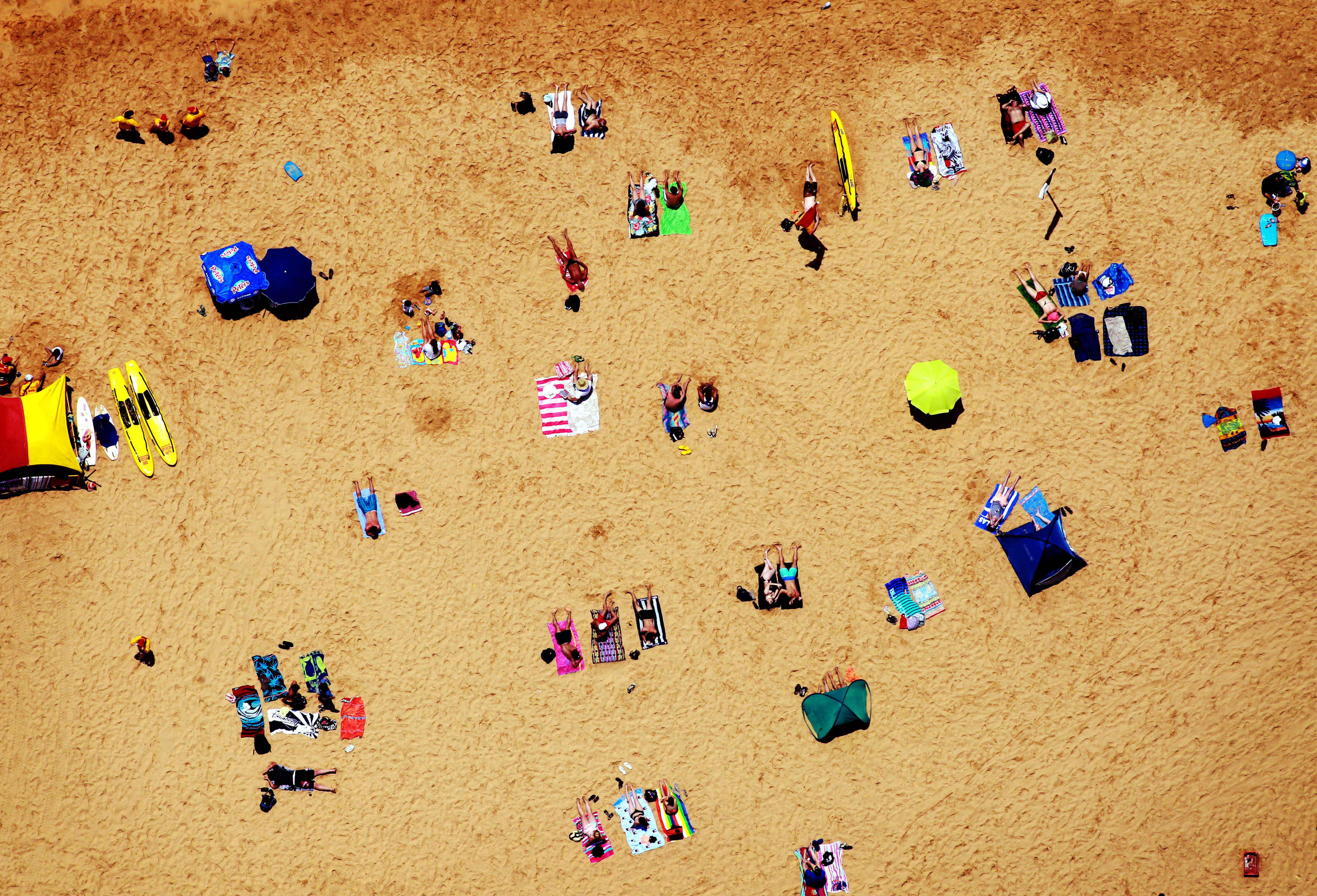 Beachgoers relax at Terrigal Beach as summer arrives on the Central Coast of New South Wales, Australia, Dec. 1, 2012.