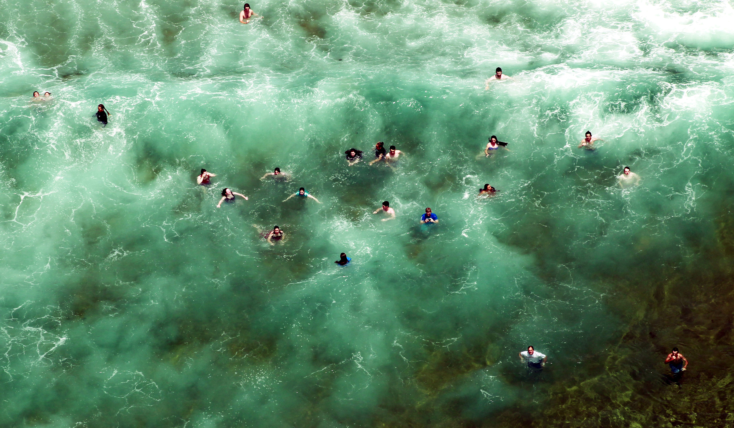 People escape the heat in the water at Avoca Beach as summer arrives on the Central Coast of New South Wales, Australia, Dec. 1, 2012.