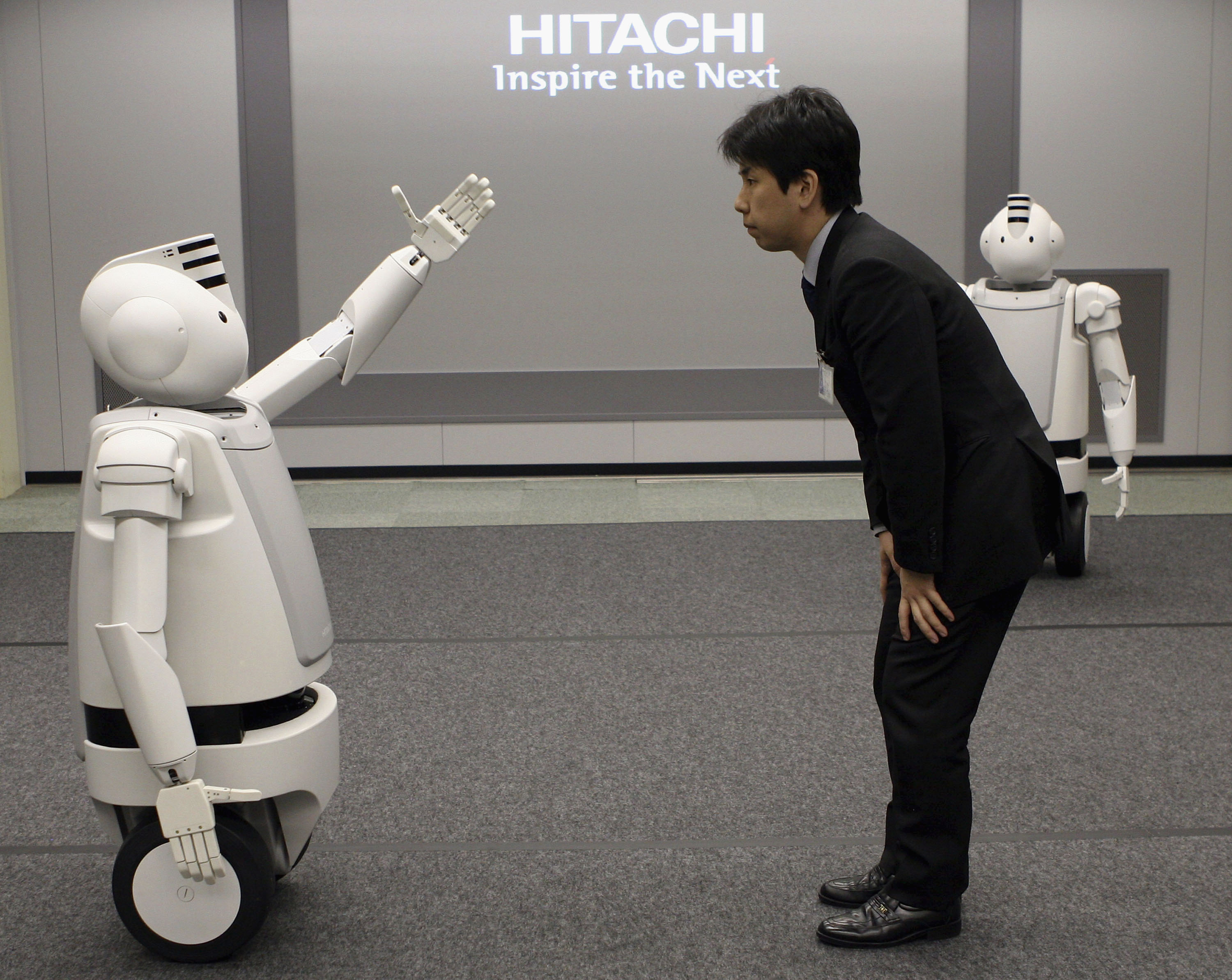 Japanese Electronics Conglomerate Hitachis New Humaniod Robot 'Emiew'
