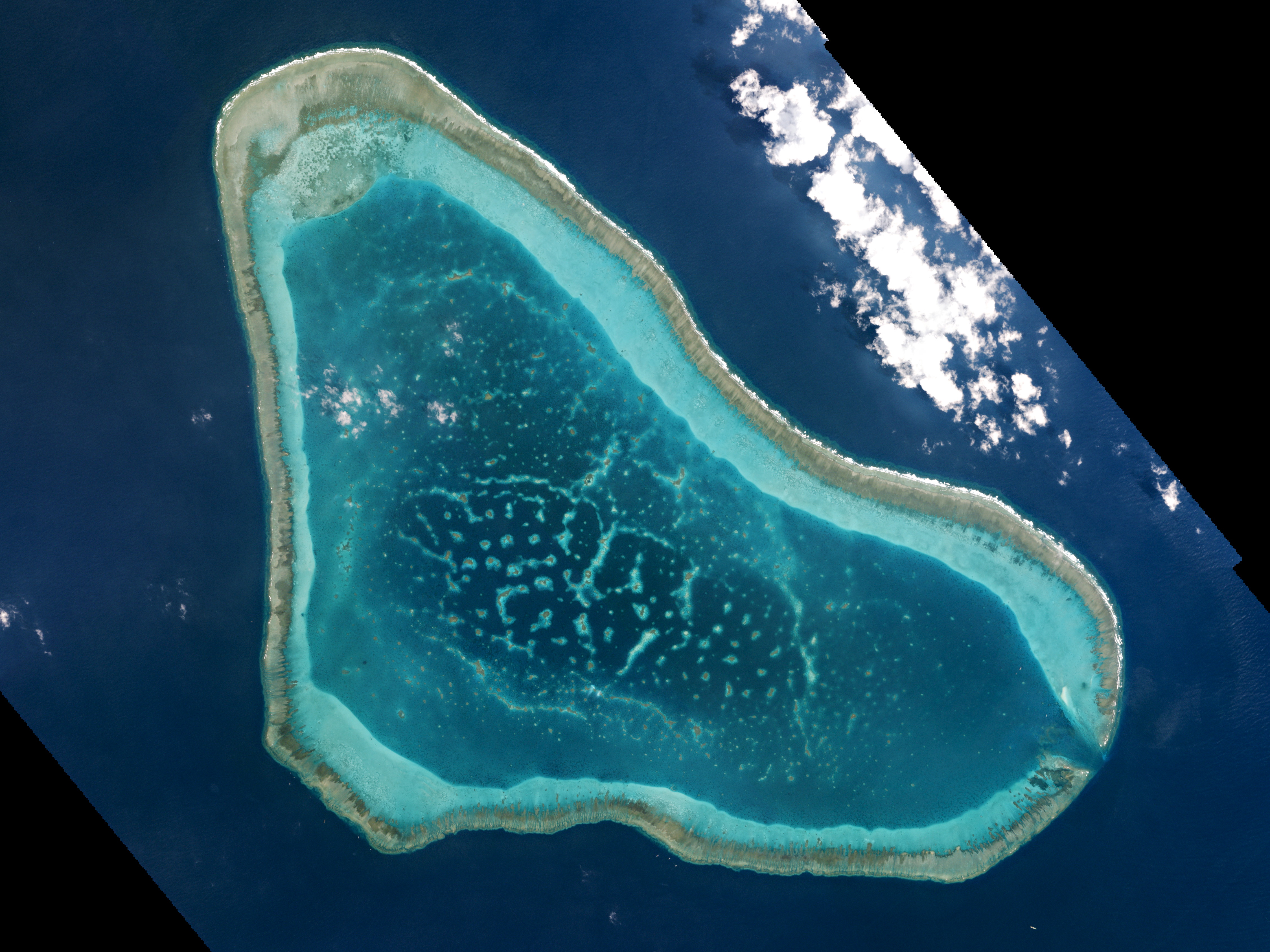 Boats at Scarborough Shoal in the South China Sea are shown in this handout photo provided by Planet Labs, and captured on March 12, 2016
