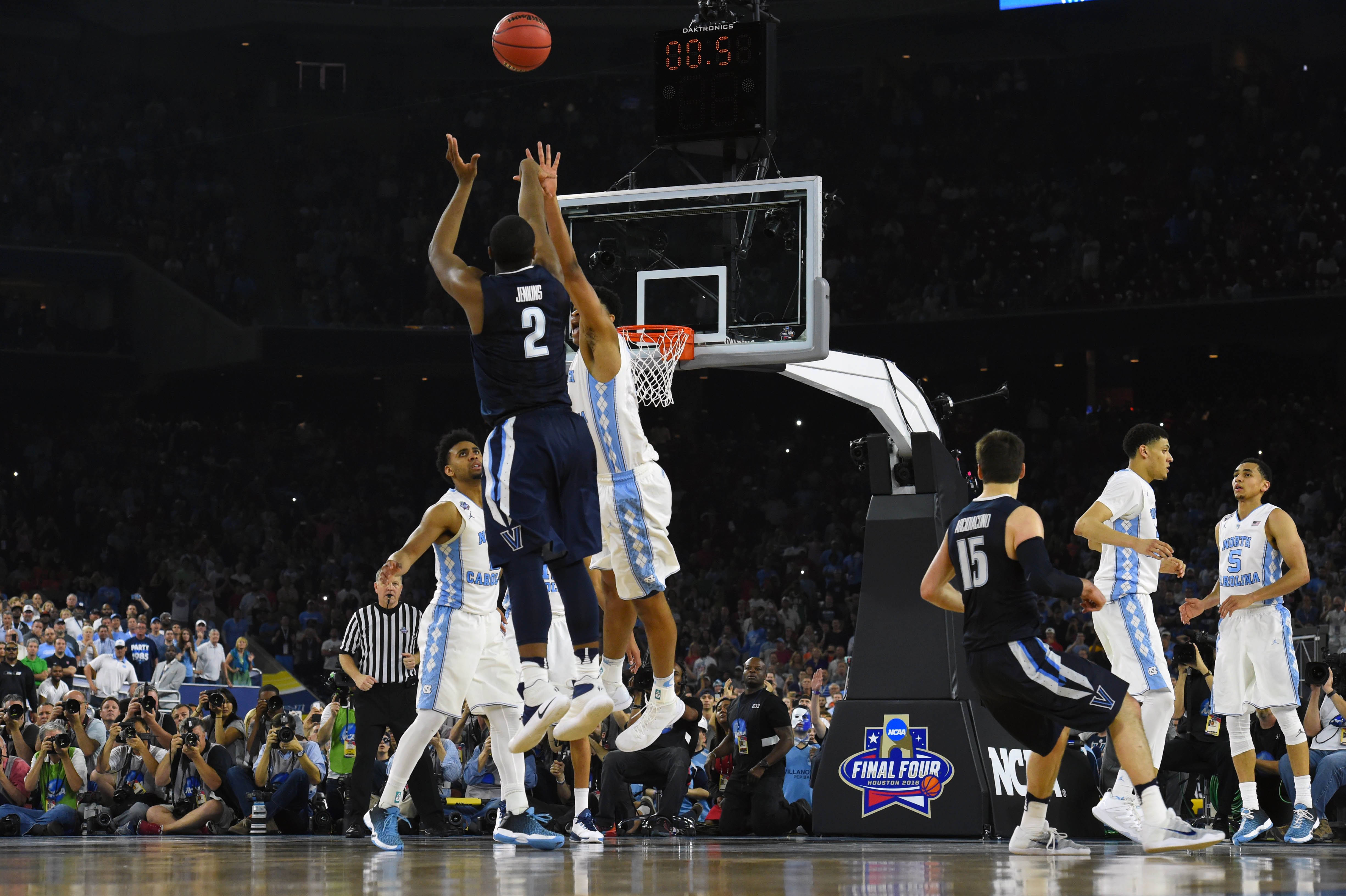 Villanova Wildcats forward Kris Jenkins (2) hits the game winning shot with .6 seconds over North Carolina Tar Heels forward Isaiah Hicks (4) in the championship game of the 2016 NCAA Men's Final Four.