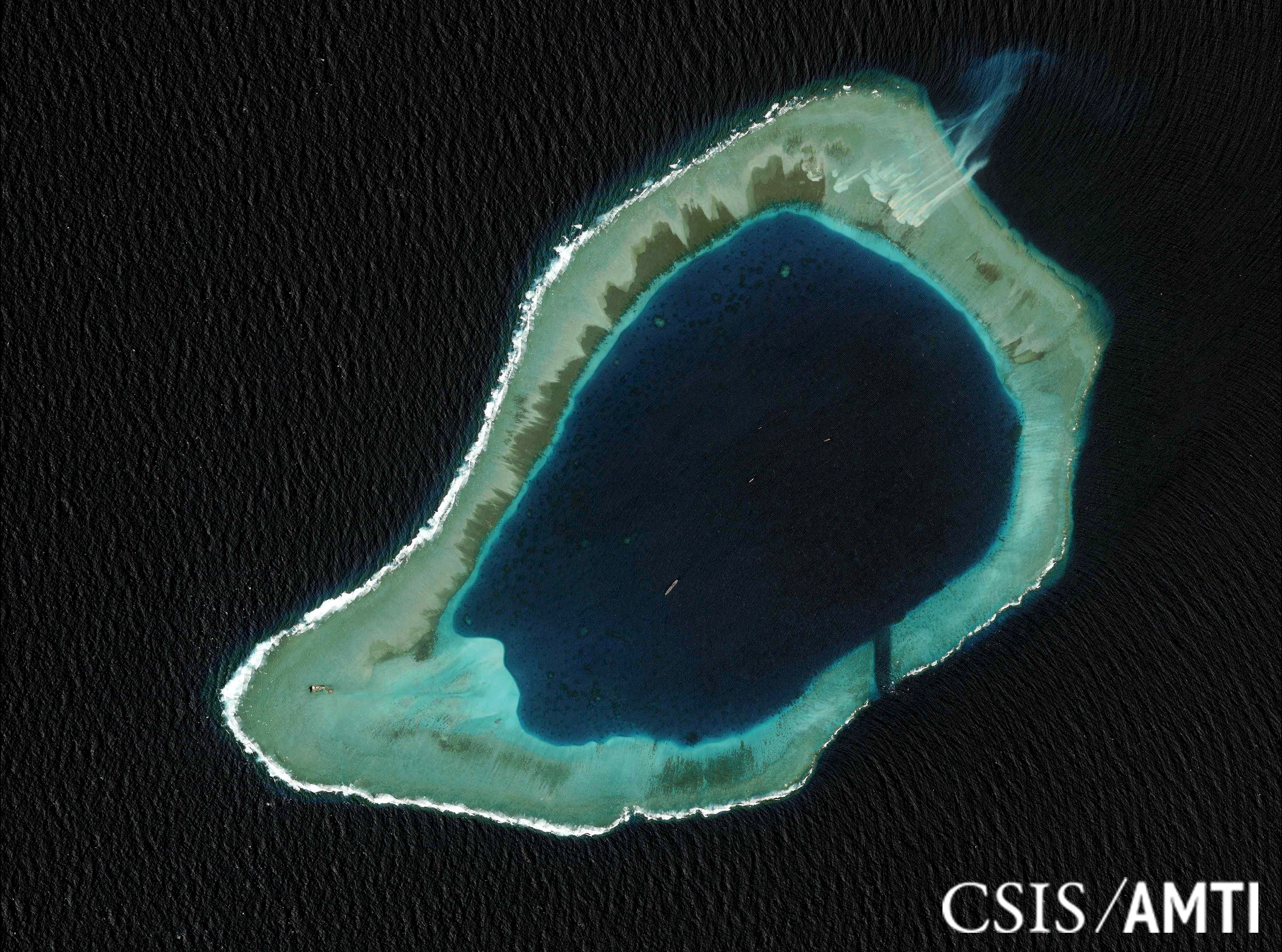 Subi Reef, located in the disputed Spratly Islands in the South China Sea, is shown in this handout Center for Strategic and International Studies Asia Maritime Transparency Initiative satellite file image taken Aug. 8, 2012, and released to Reuters on Oct. 27, 2015
