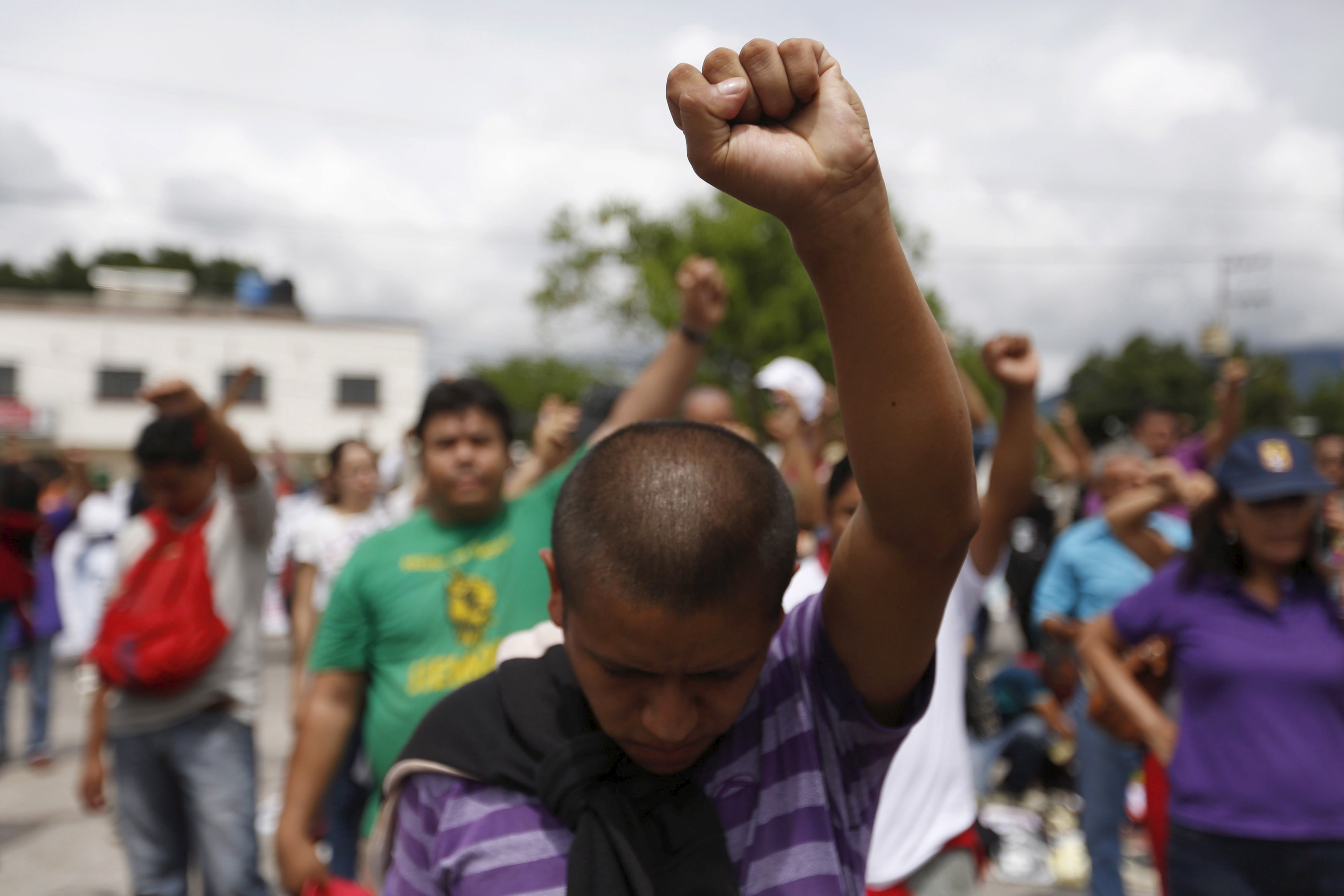 A man gestures during a march organized by parents and relatives of the 43 missing students of Ayotzinapa College Raul Isidro Burgos in Iguala, in the Mexican state of Guerrero, September 27, 2015
