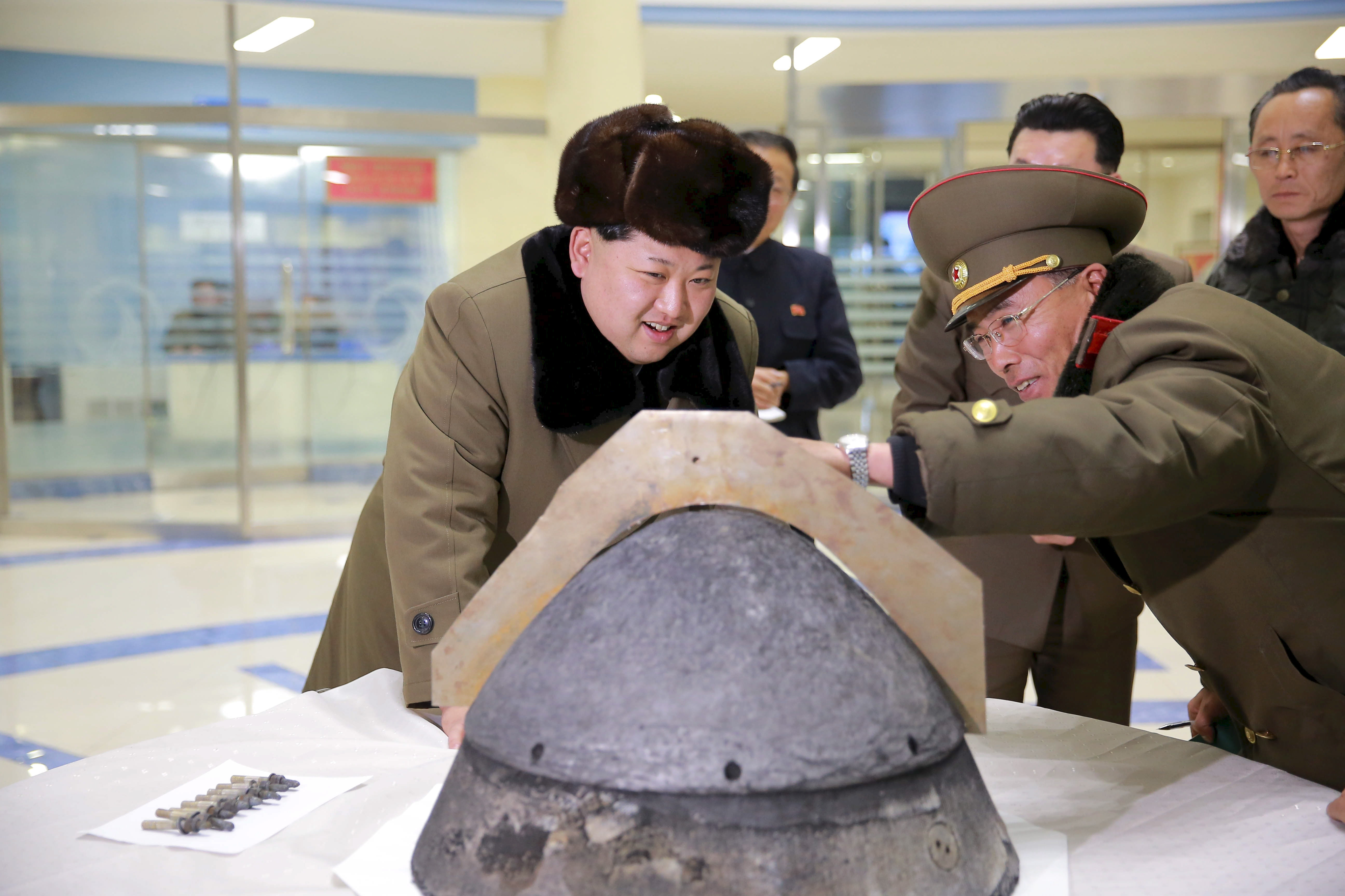 North Korean leader Kim Jong Un looks at a rocket warhead tip at an unidentified location in this undated file photo released by North Korea's Korean Central News Agency in Pyongyang, March 15, 2016