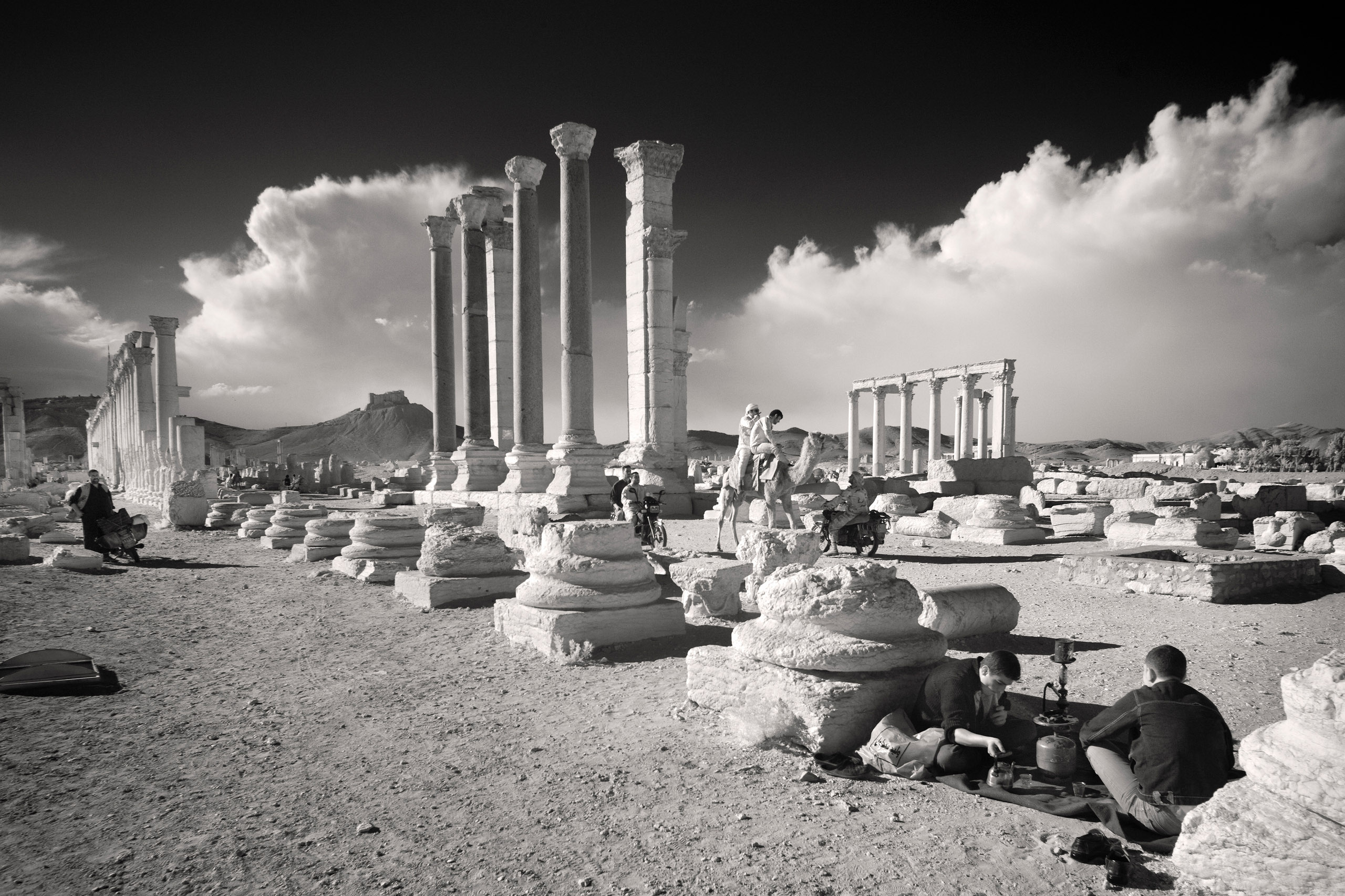 Many locals picnic, stroll, ride horses and motorbikes among the ruins of Palmyra.