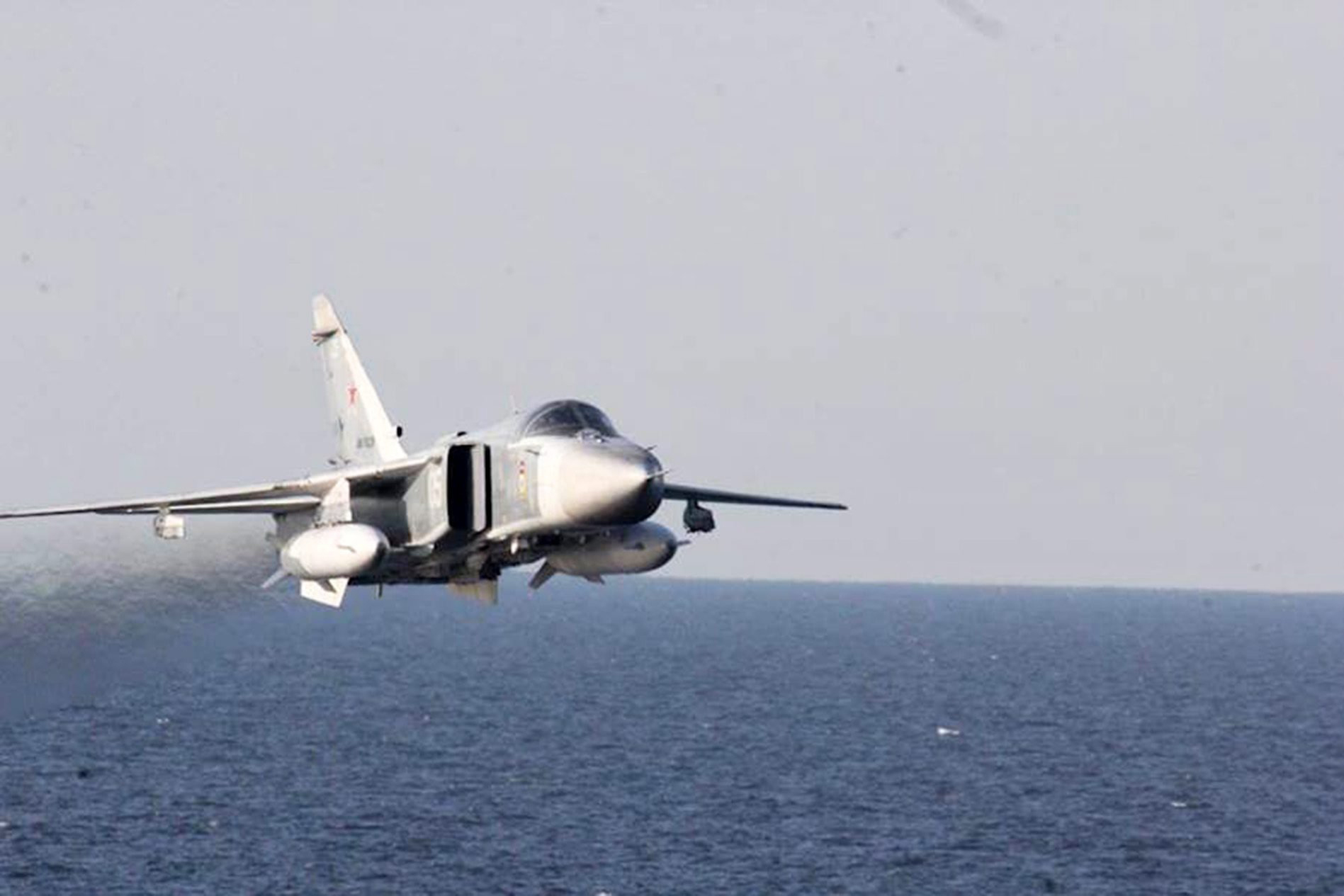 A handout image made available on 13 April 2016 by the US Navy shows A Russian Sukhoi Su-24 attack aircraft makes a low altitude pass by USS Donald Cook (DDG 75) in the Baltic Sea on 12 April 2016.
