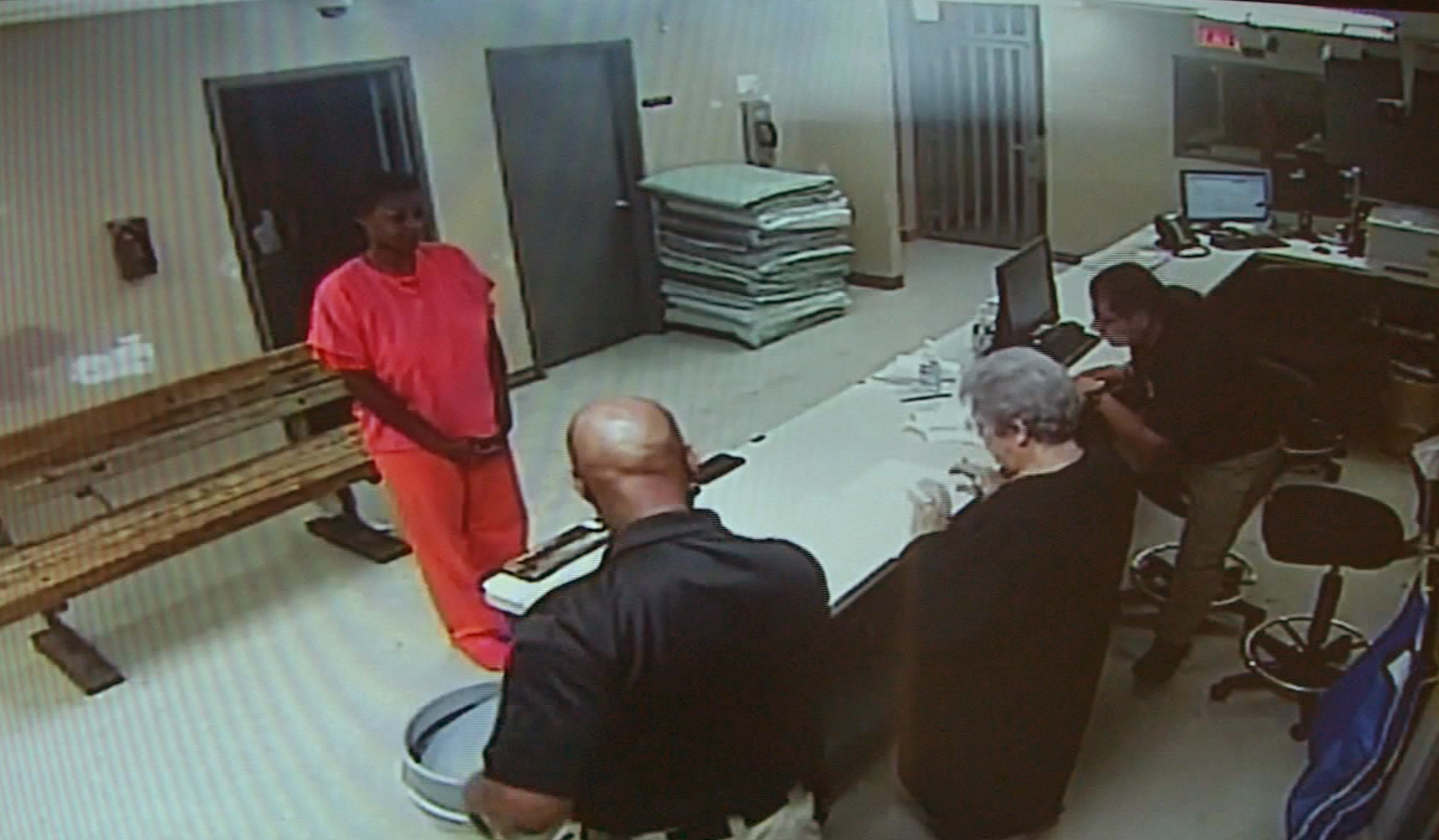 In this undated file image made from video provided by the Waller County Sheriff's Department, Sandra Bland stands before a desk at Waller County Jail in Hempstead, Texas.