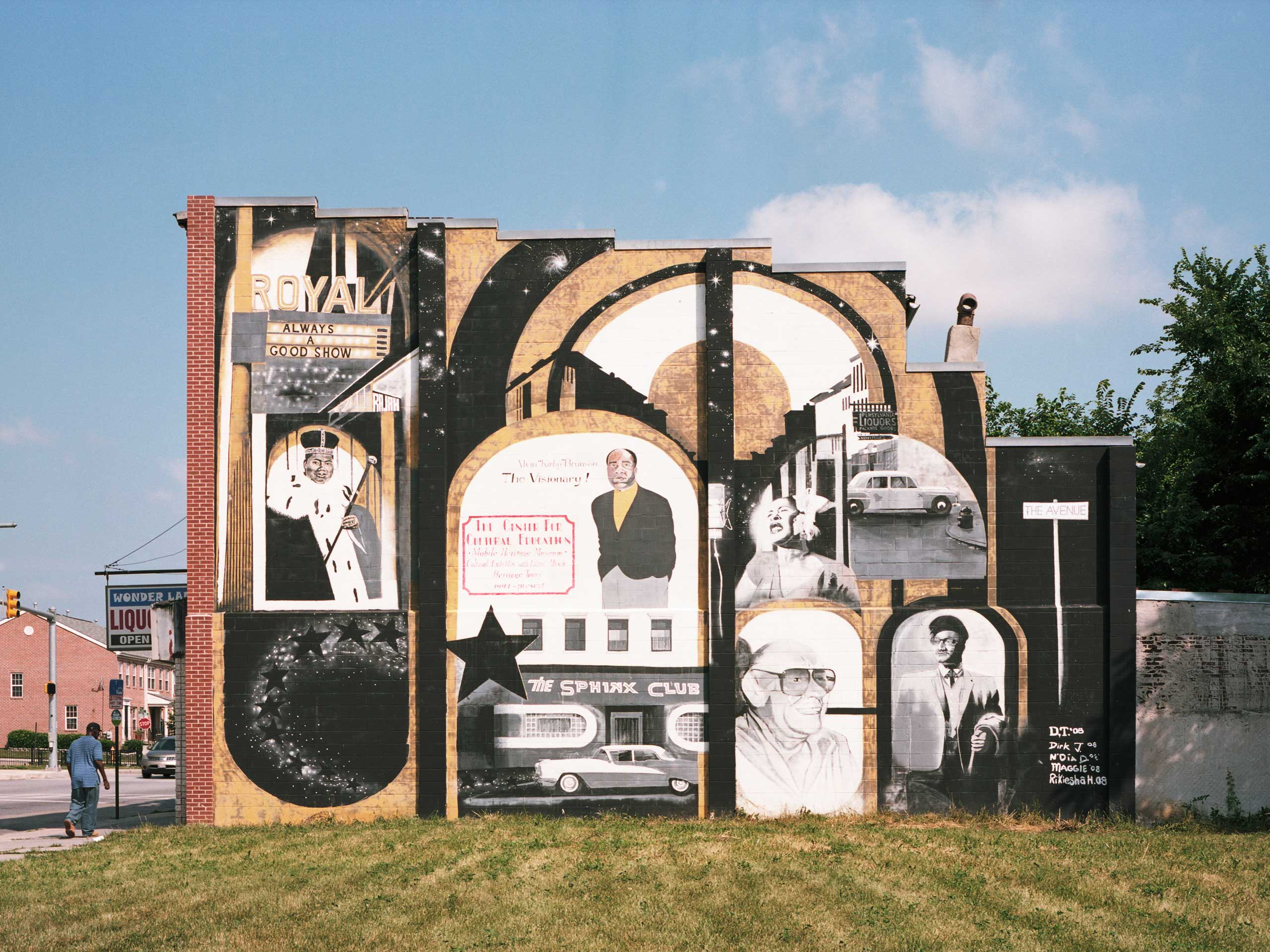 A mural celebrating the musical heritage of Sandtown adorns the side of a building on Pennsylvania Avenue near Presstman Street. With multiple music venues, the Sandtown-Winchester neighborhood was the Harlem of Baltimore, catering to black musicians, artists, writers and intellectuals in the 1950s and 1960s. The Sphinx Club, located near this mural, was once one of the most important music clubs in Baltimore. Louis Armstrong and Fats Waller worked as accompanists and Louis Jordan, Duke Ellington, Etta James, Nat King Cole, The Temptations, The Supremes and Count Basie all performed at the Sphinx.