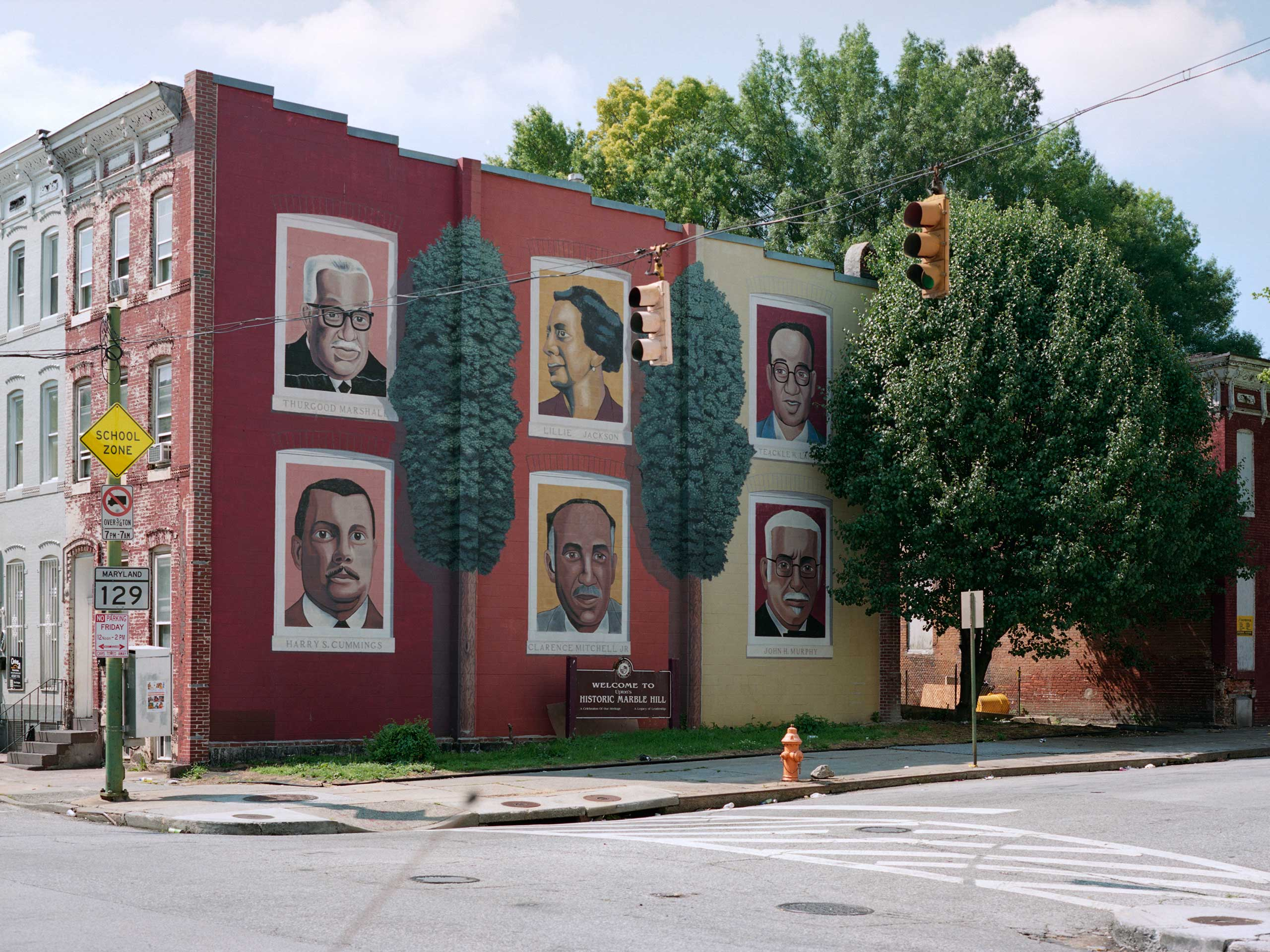 A mural celebrating famous residents of West Baltimore, including the first black Supreme Court Justice, Thurgood Marshall, covers the corner of Druid Hill Avenue and Laurens Street.