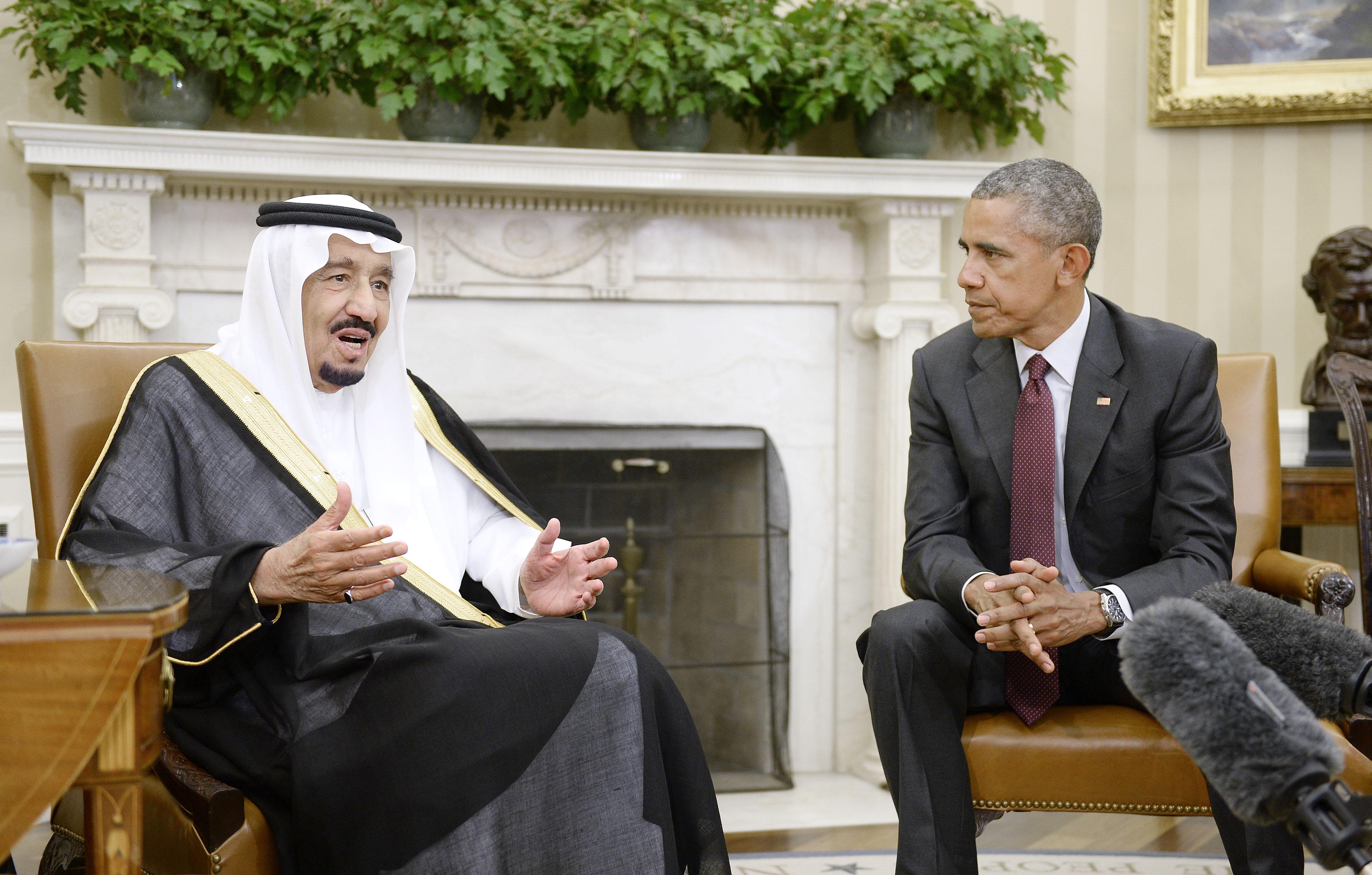 U.S. President Barack Obama looks on as King Salman bin Abd alaziz of Saudi Arabia speaks during a  bilateral meeting in the Oval Office of the White House in Washington, D.C., on Sept. 4, 2015.