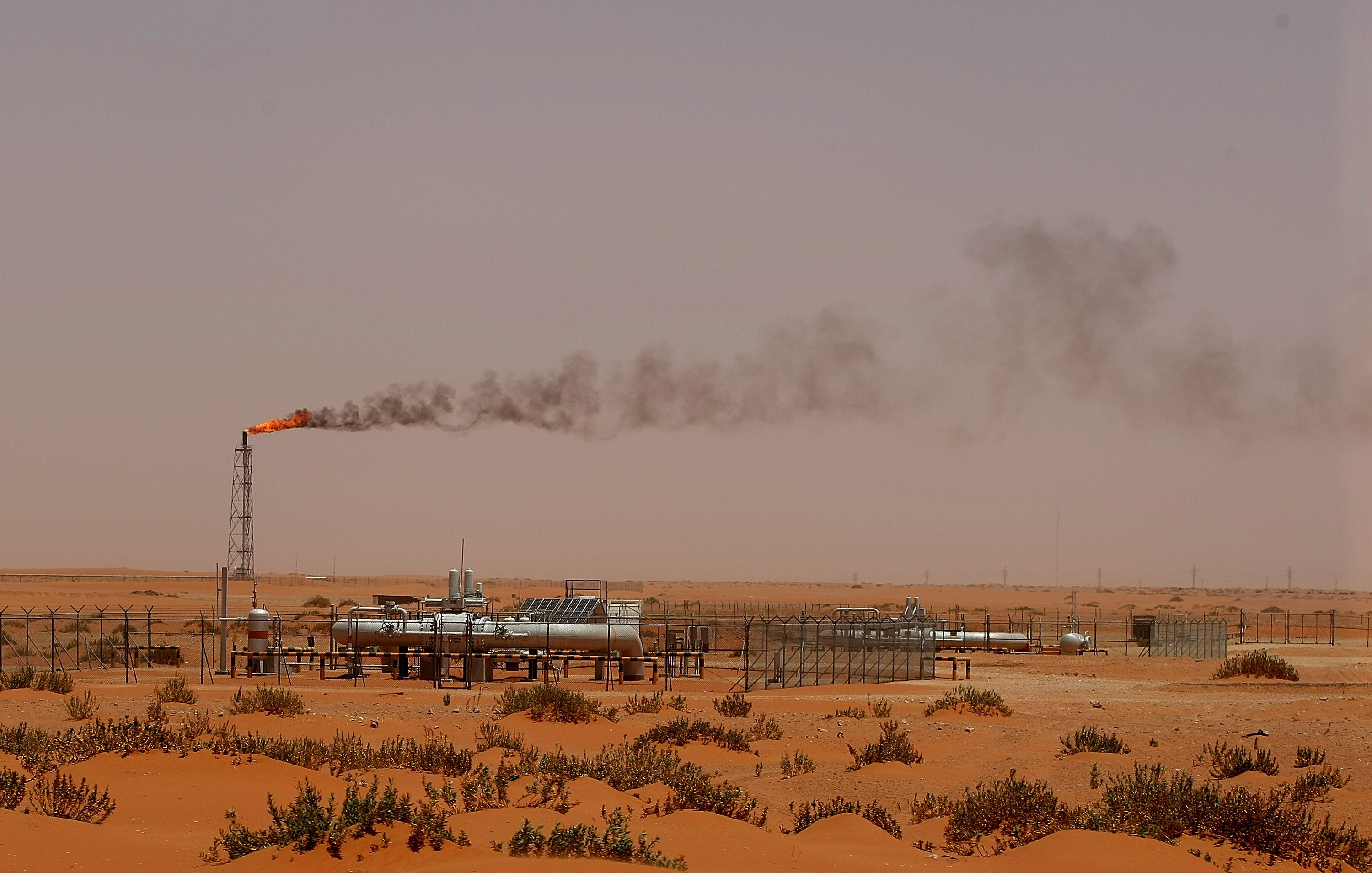 A flame from a Saudi Aramco oil installion known as  Pump 3  is seen in the desert near the oil-rich area of Khouris, 160 kms east of the Saudi capital Riyadh, on June 23, 2008.