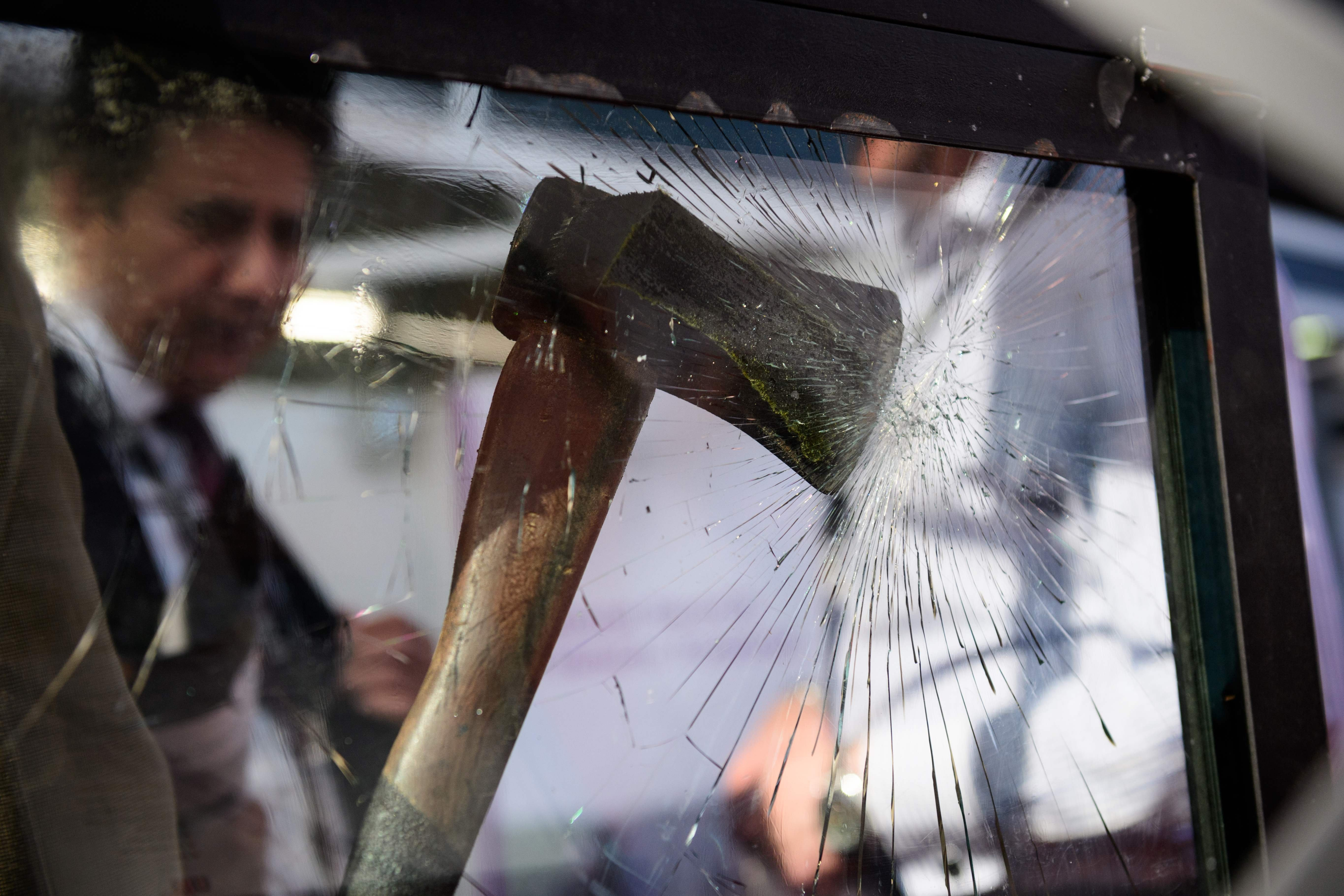 An axe and the effect it has on ballistic glass is displayed during the  Security and Counter Terror Expo  at the Olympia centre in west London on April 19, 2016.