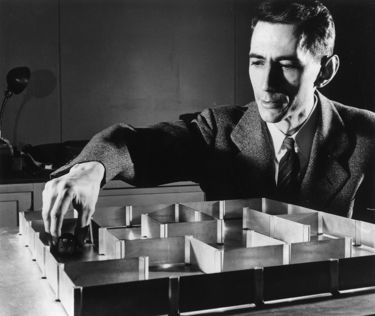 Dr. Claude E Shannon with an electronic mouse which has a 'super' memory and can learn its way round a maze without a mistake after only one 'training' run, on May 10, 1952
