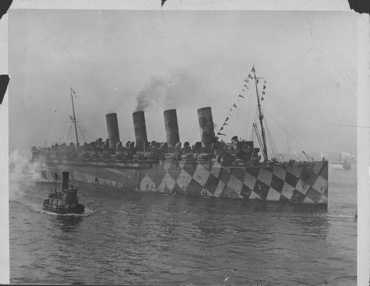 US World War One warship with dazzle camouflage heading to Europe from the USA, circa 1914-1918.
