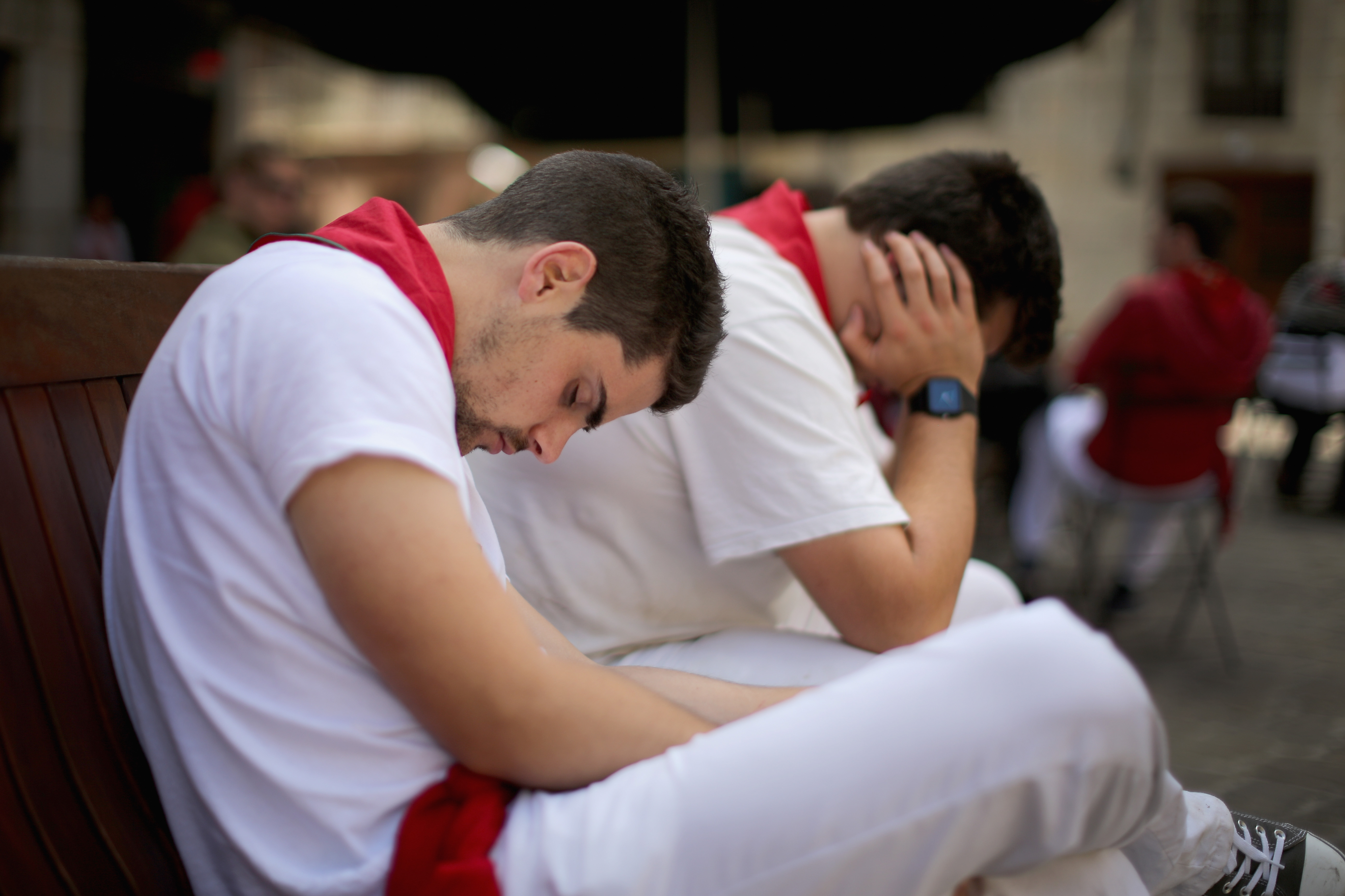 Revellers take an afternoon siesta sleeping off the effects of partying during the fourth day of the San Fermin Running Of The Bulls festival, on July 9, 2014 in Pamplona, Spain.