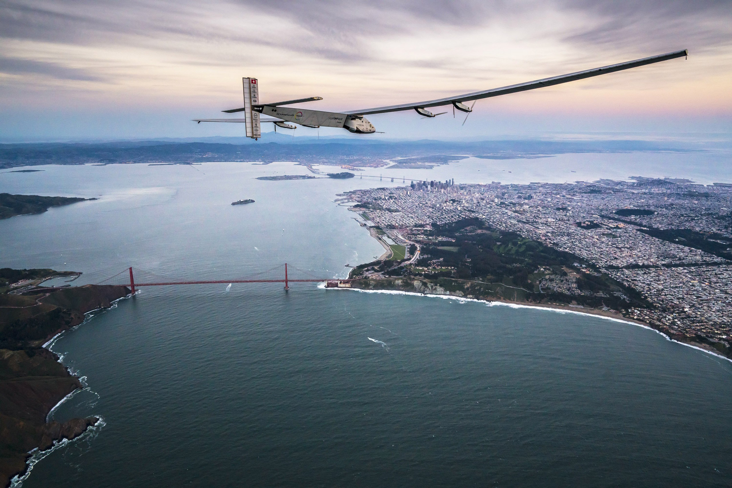 Solar powered plane 'Solar Impulse 2', piloted by Swiss adventurer Bertrand Piccard, flies over the Golden Gate bridge in San Francisco before landing in Mountain View, Calif., on April 23, 2016.