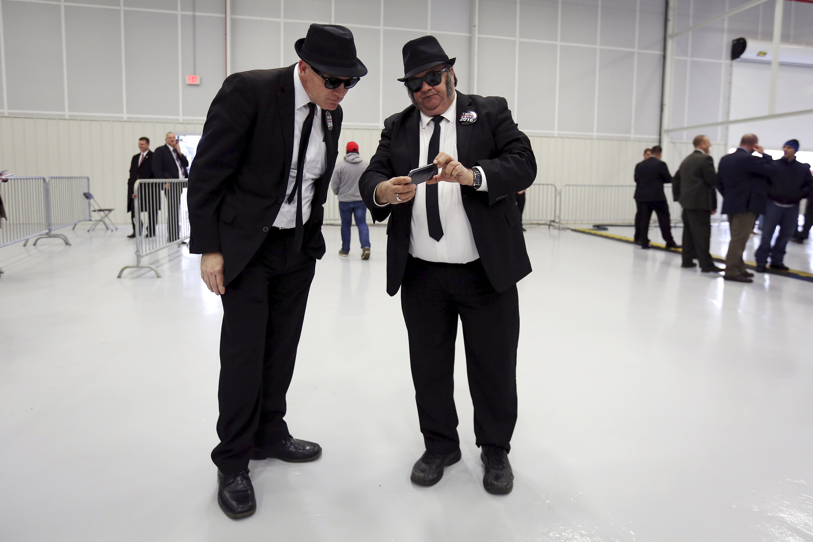 Men dressed up as Jake and Elwood Blues from the Blues Brothers movie attend a campaign event for Donald Trump in Rome, N.Y. on April 12, 2016.