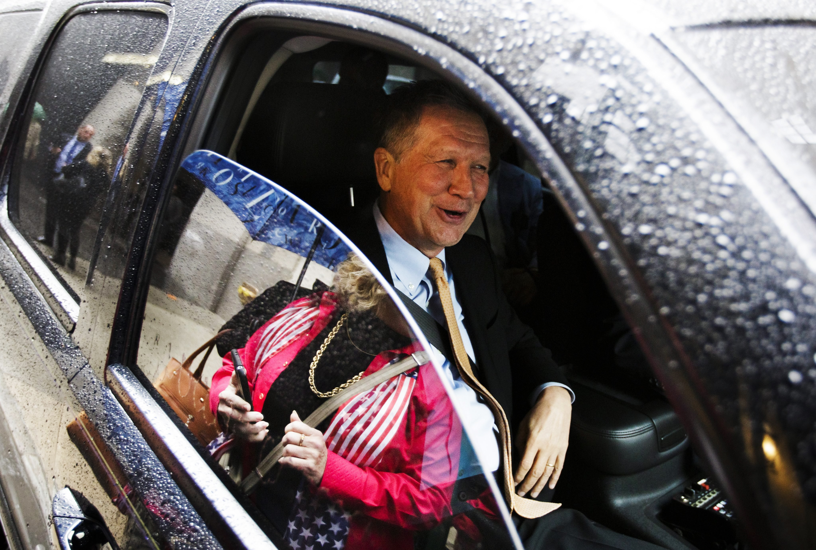 Republican presidential candidate, Ohioh Gov. John Kasich talks to reporters from his car in New York on April 12, 2016.