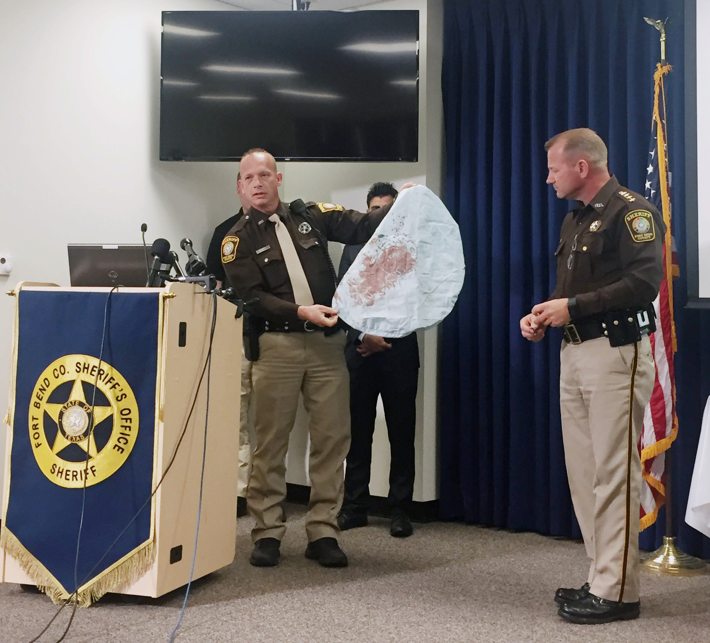 Deputy Danny Beckworth displays part of a defective airbag believed to have killed 17-year-old Huma Hanif during a news conference in Houston on April 7, 2016.