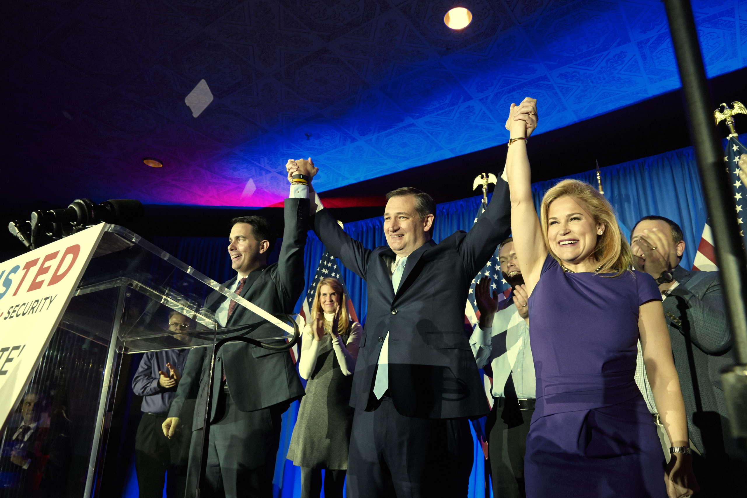 Senator Ted Cruz celebrates winning the Wisconsin primary with his wife Heidi and Governor Scott Walker in Milwaukee on April 5