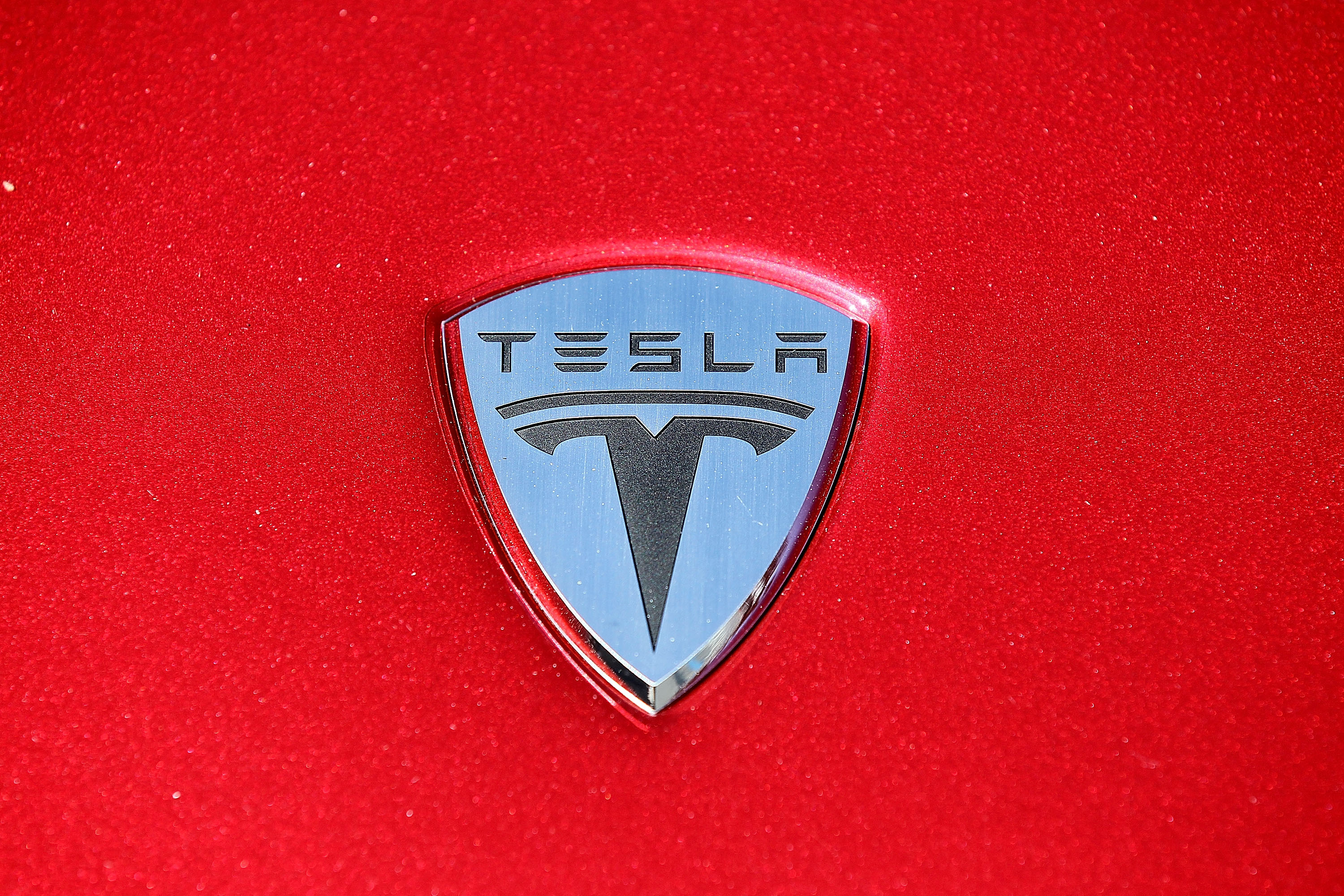 The Tesla Motors logo is seen on the hood of a car at Tesla Motors headquarters May 20, 2010 in Palo Alto, California.