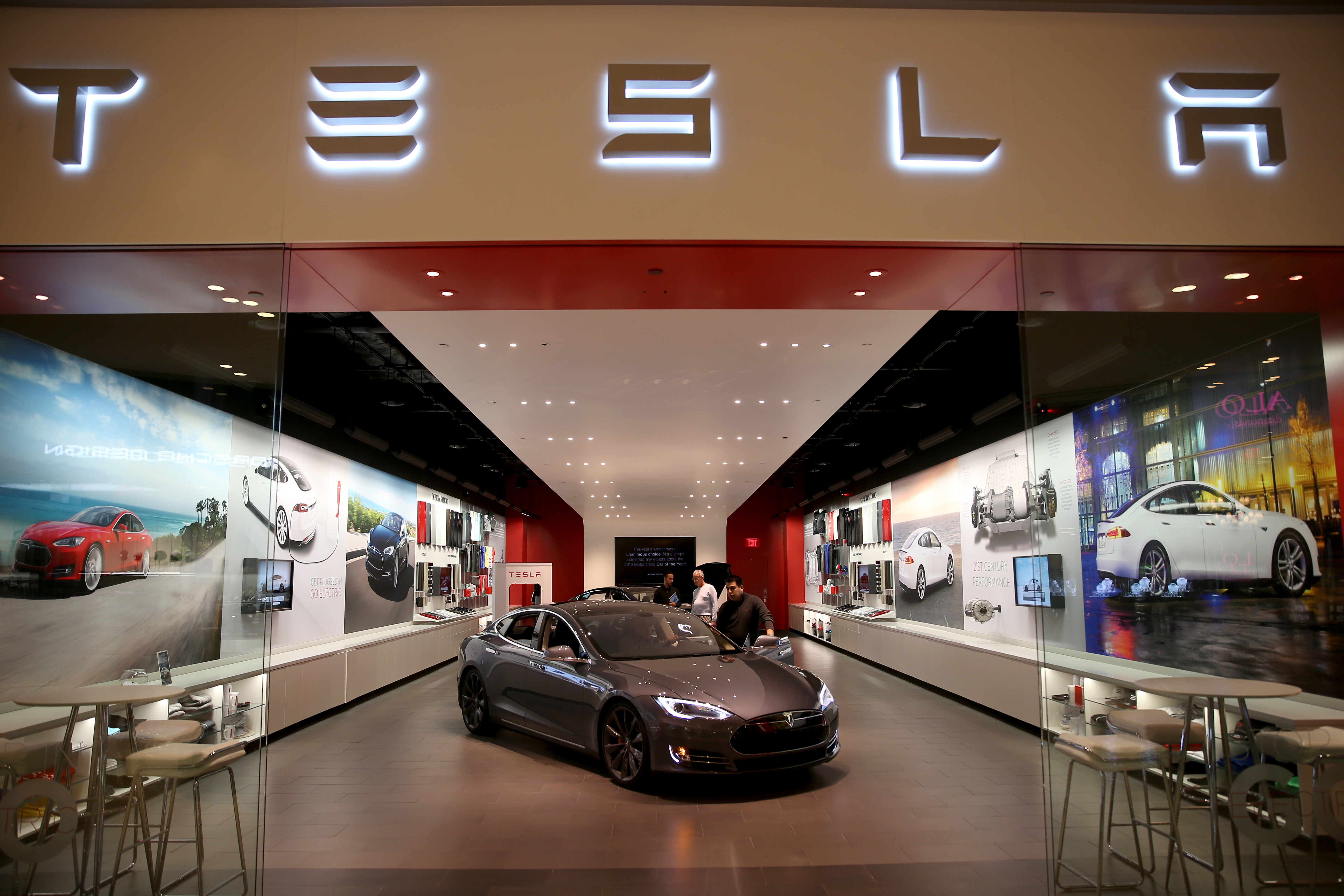 People look at a Tesla Motors vehicle on the showroom floor at the Dadeland Mall on February 19, 2014 in Miami, Florida.