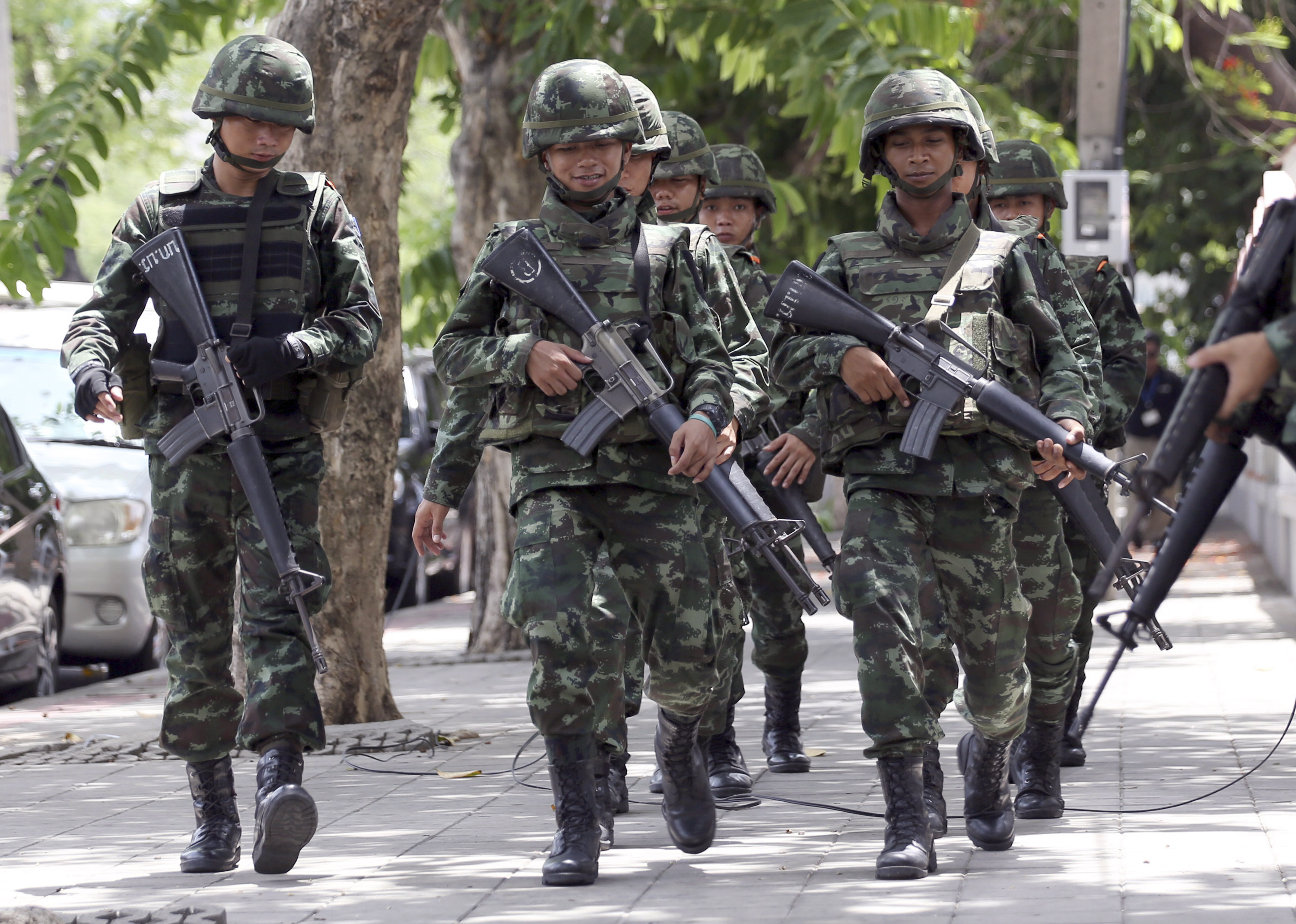 In this May 29, 2014, file photo, Thai soldiers march while changing positions with fellow soldiers on a street in Bangkok