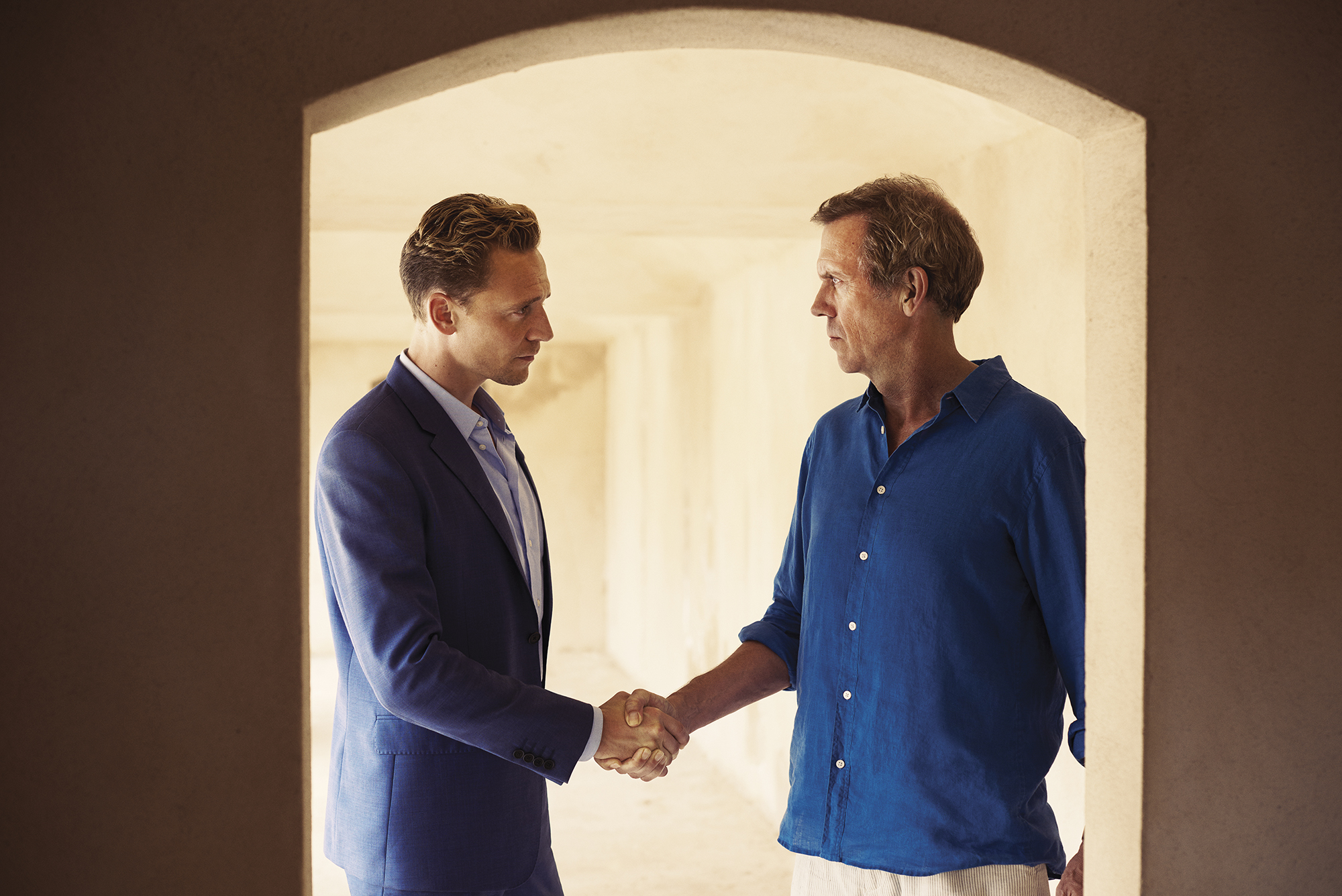 Tom Hiddleston as Jonathan Pine and Hugh Laurie as Richard Roper in The Night Manager, 2016