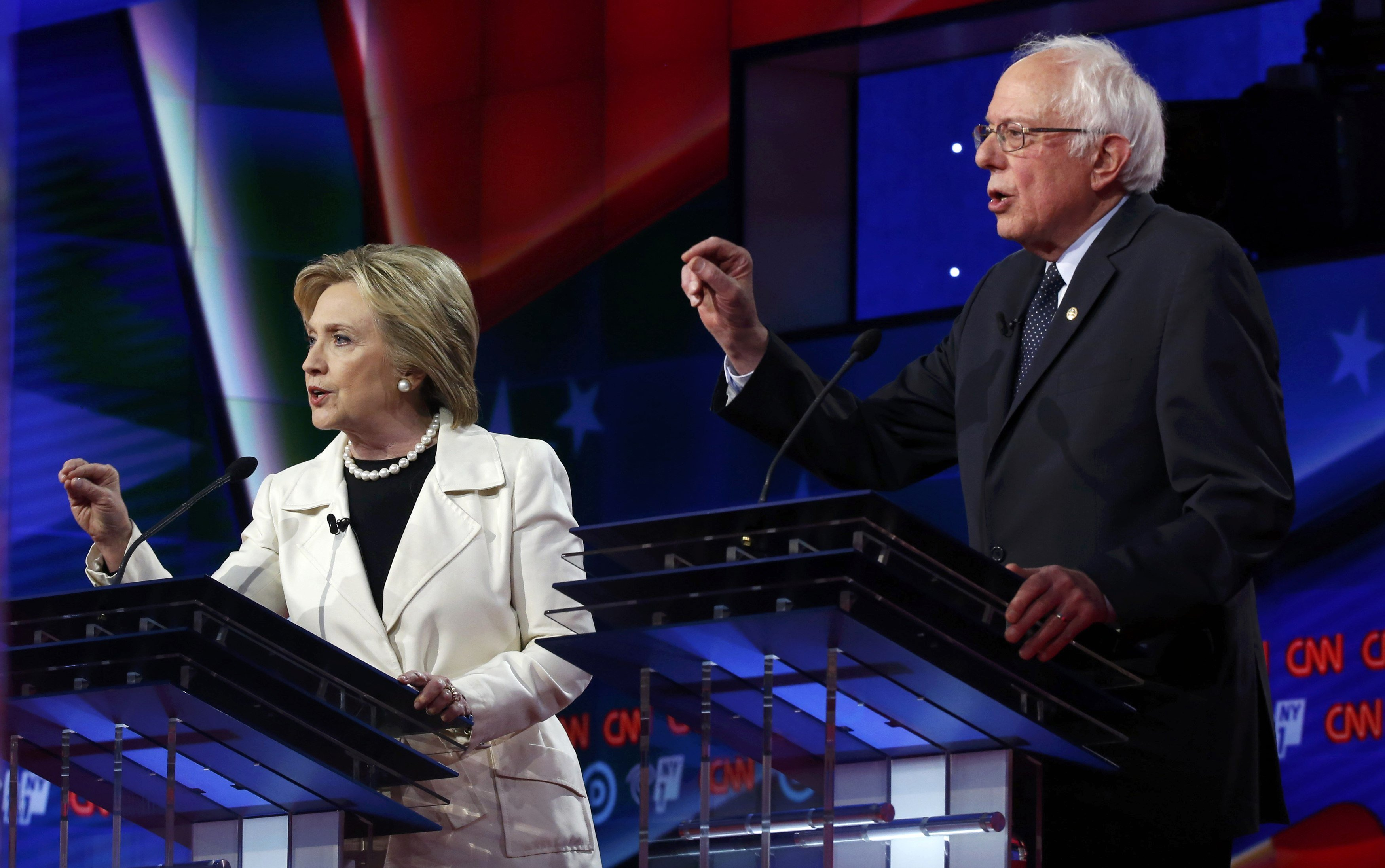 Democratic presidential candidates Hillary Clinton and Senator Bernie Sanders speak simultaneously during a Democratic debate hosted by CNN and New York One at the Brooklyn Navy Yard in New York April 14, 2016.