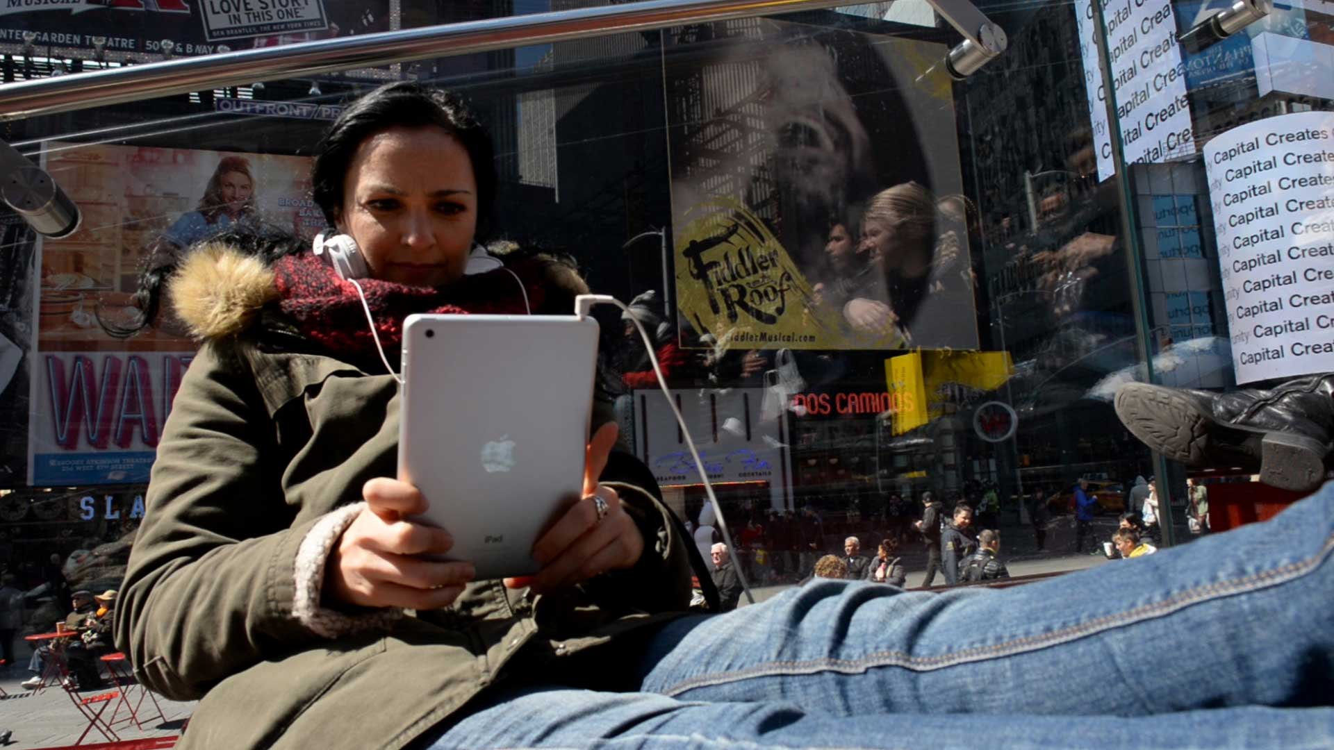 A woman holds an iPad in Times Square, N.Y.