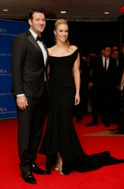 NFL football player Tony Romo and wife, Candice Crawford, arrive on the red carpet for the annual White House Correspondents Association Dinner in Washington