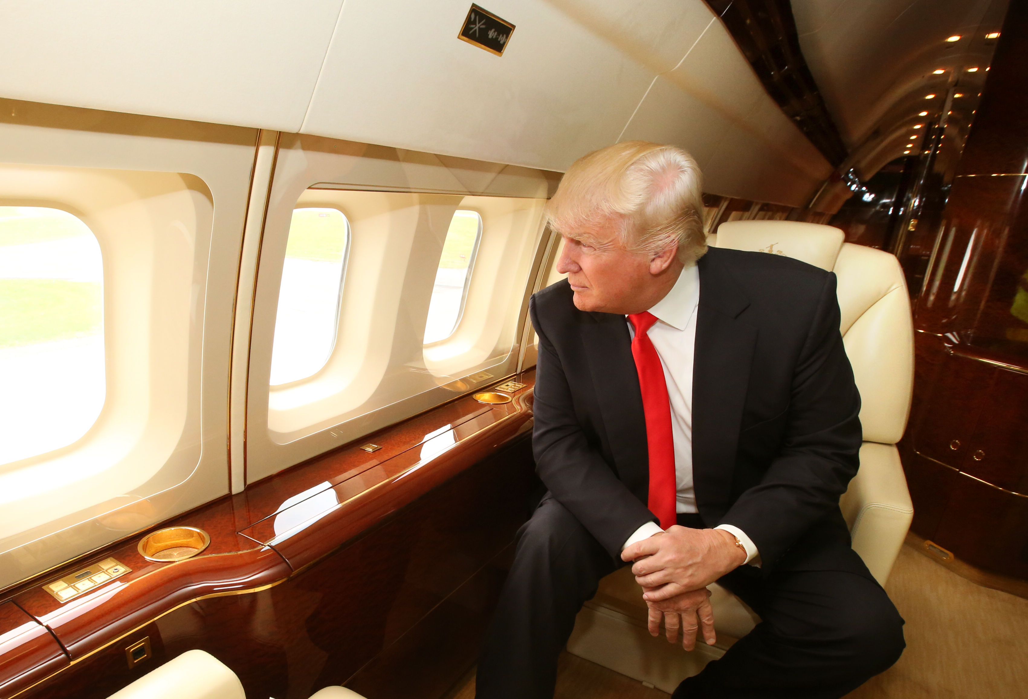 Donald Trump onboard his private jet, as he arrives at Aberdeen Airport, on May 15, 2014.