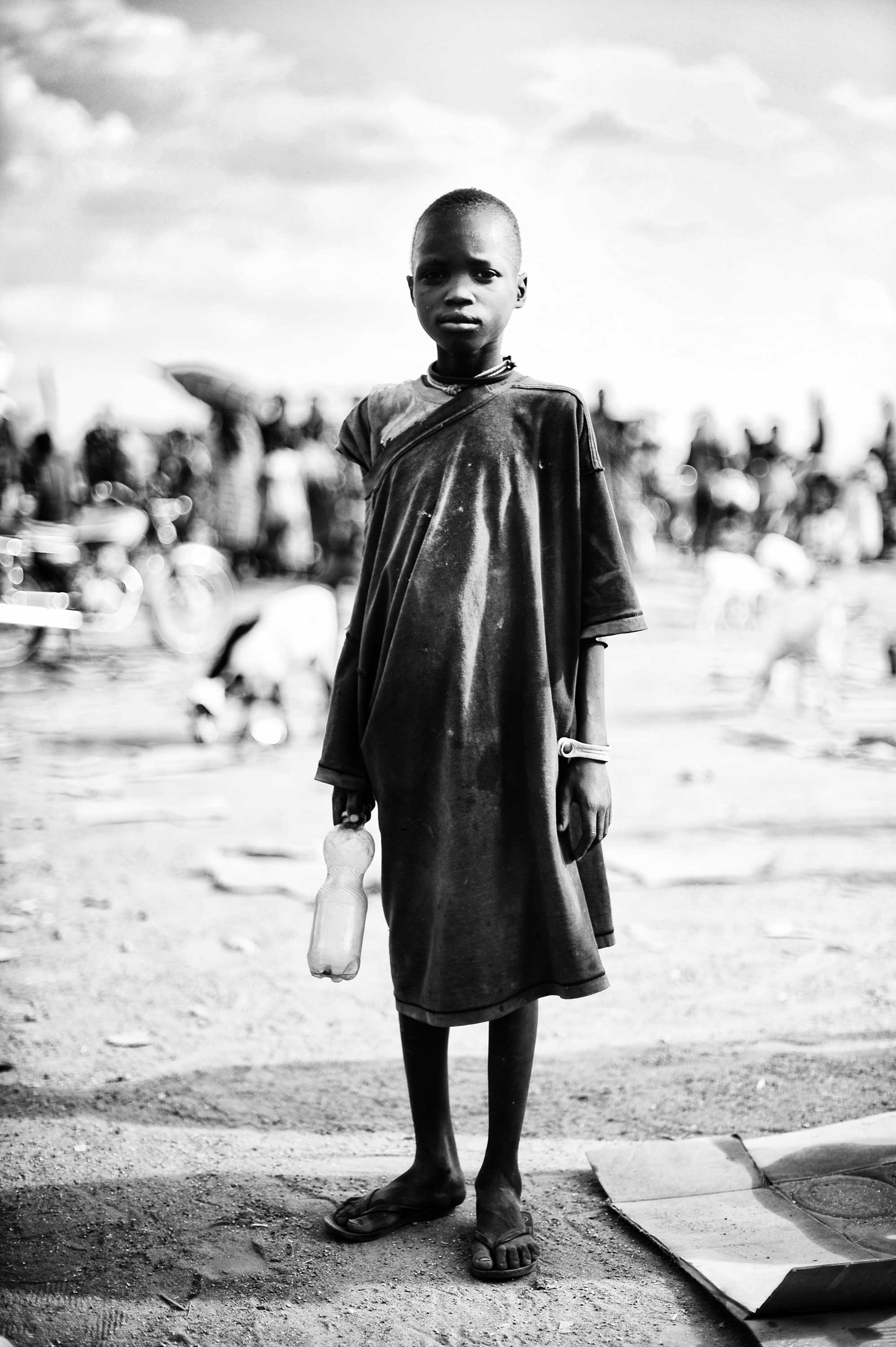 Mingkamann refugee camp, Lakes state, South Sudan: Duku, about 8 years old, reached the Mingkaman refugee camp after two months of walking. He has remained completely alone, but was greeted by another family of refugees. He has no memory of what happened to his family and does not want to talk about it.