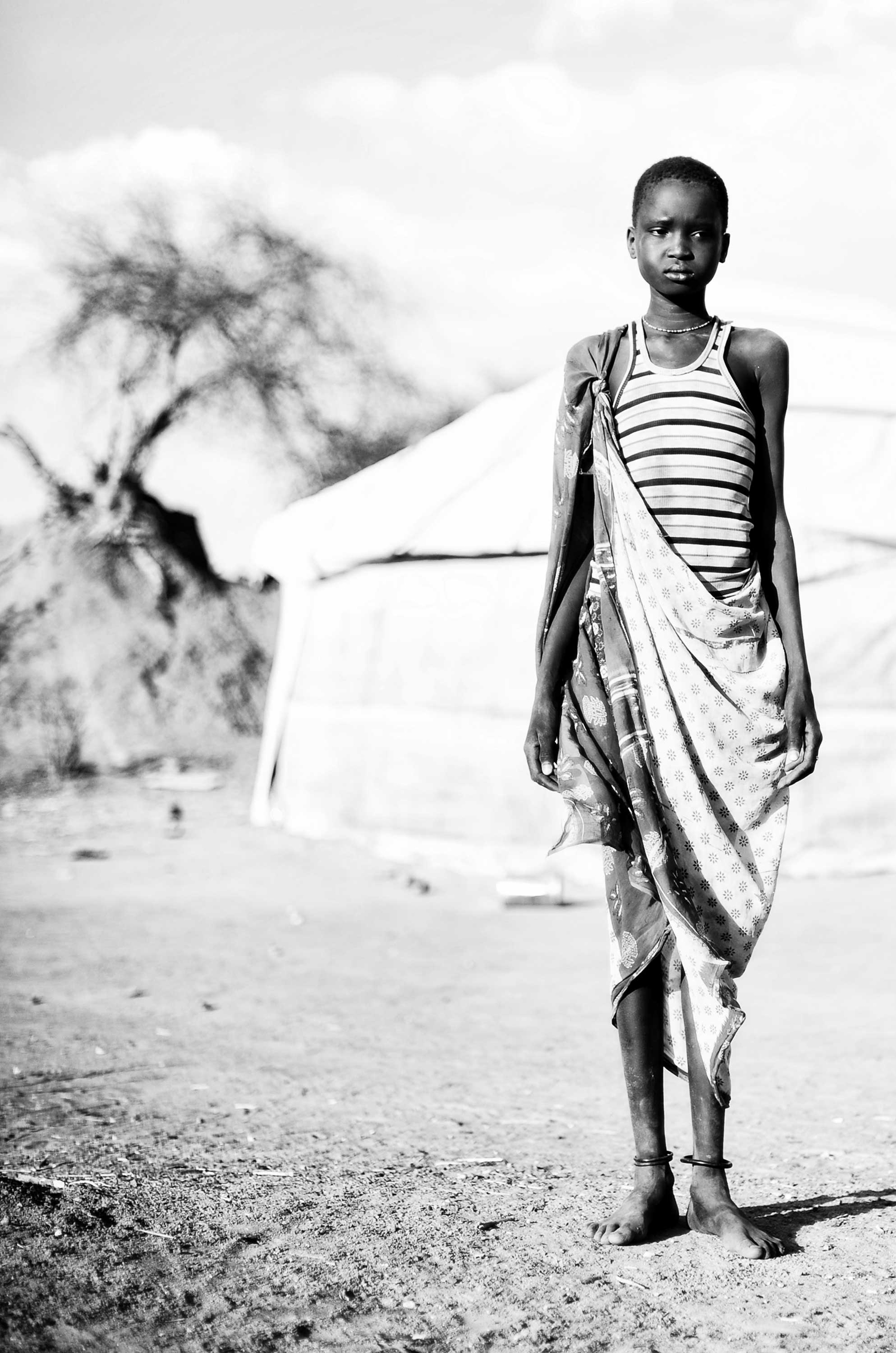 Mingkamann refugee camp, Lakes state, South Sudan: Faith, 16, fled with her family from the Upper Nile. This evening she will attend a party with the young boys in the village and  hopes to choose a mate.