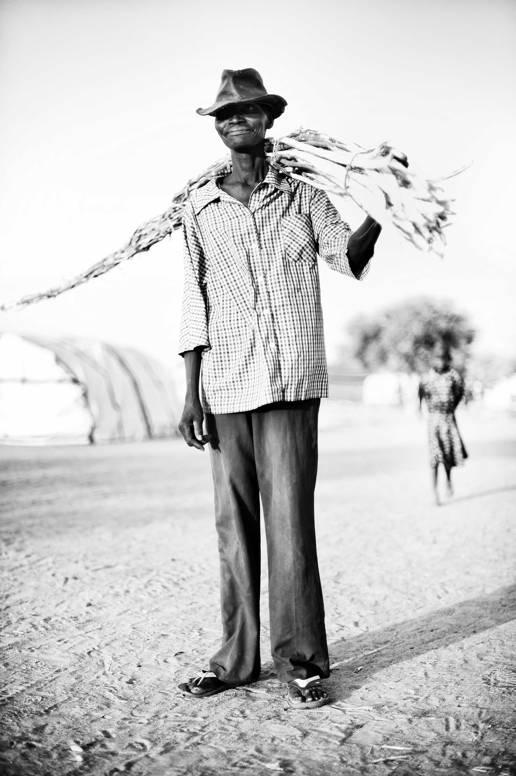 Mingkamann refugee camp, Lakes state, South Sudan: Juma, 38, fled to Mingkaman because of clashes in the Jonglei state. He lives in the refugee camp with his wife. He hopes to build a house with wooden branches and mud, because they no longer want to live in a tent.