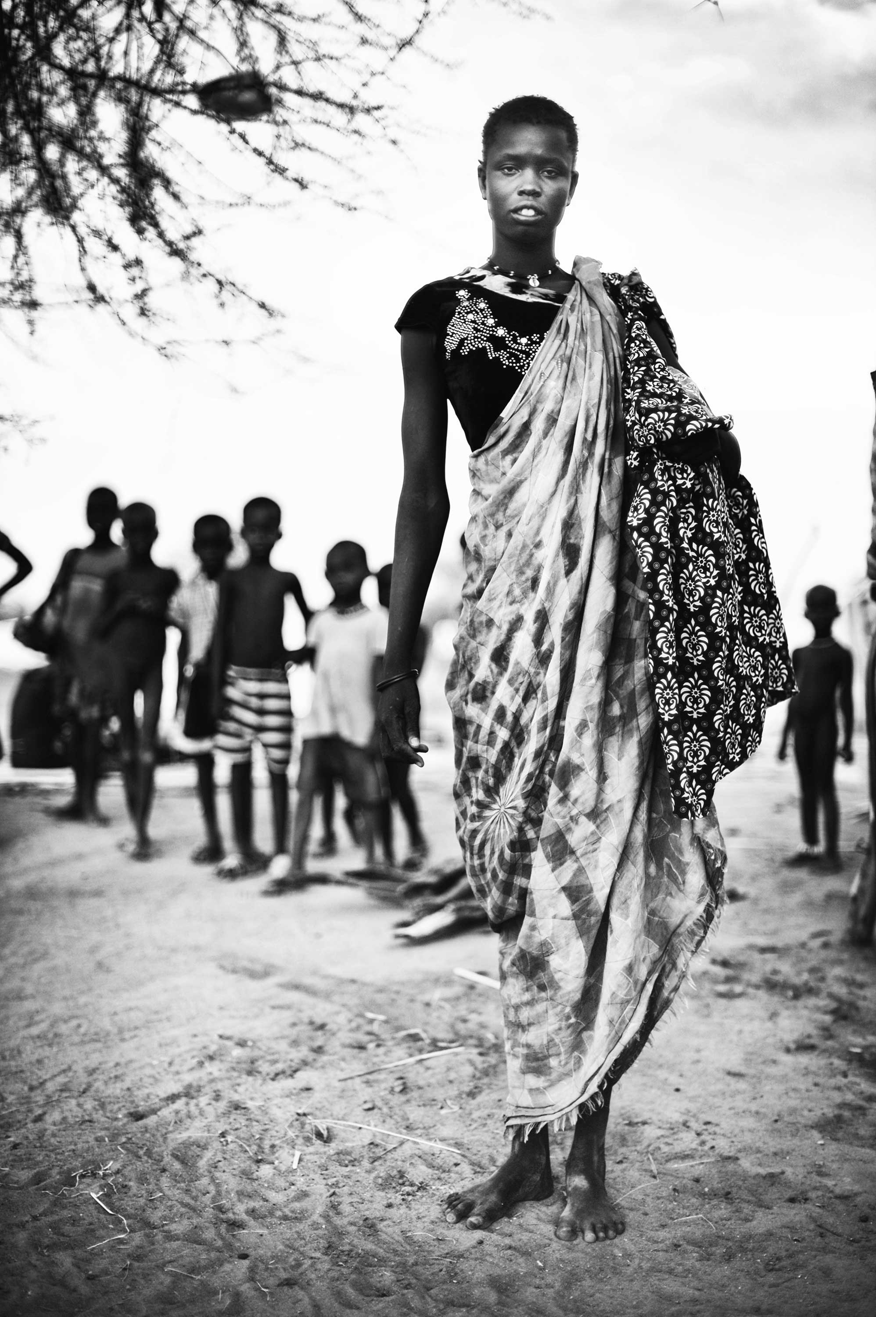 Mingkamann refugee camp, Lakes state, South Sudan: Ayen, 28, has five children. She ran away from Bor, Jonglei state, because of the fighting and violence. She does not want to speak about what happened to the rest of her family.