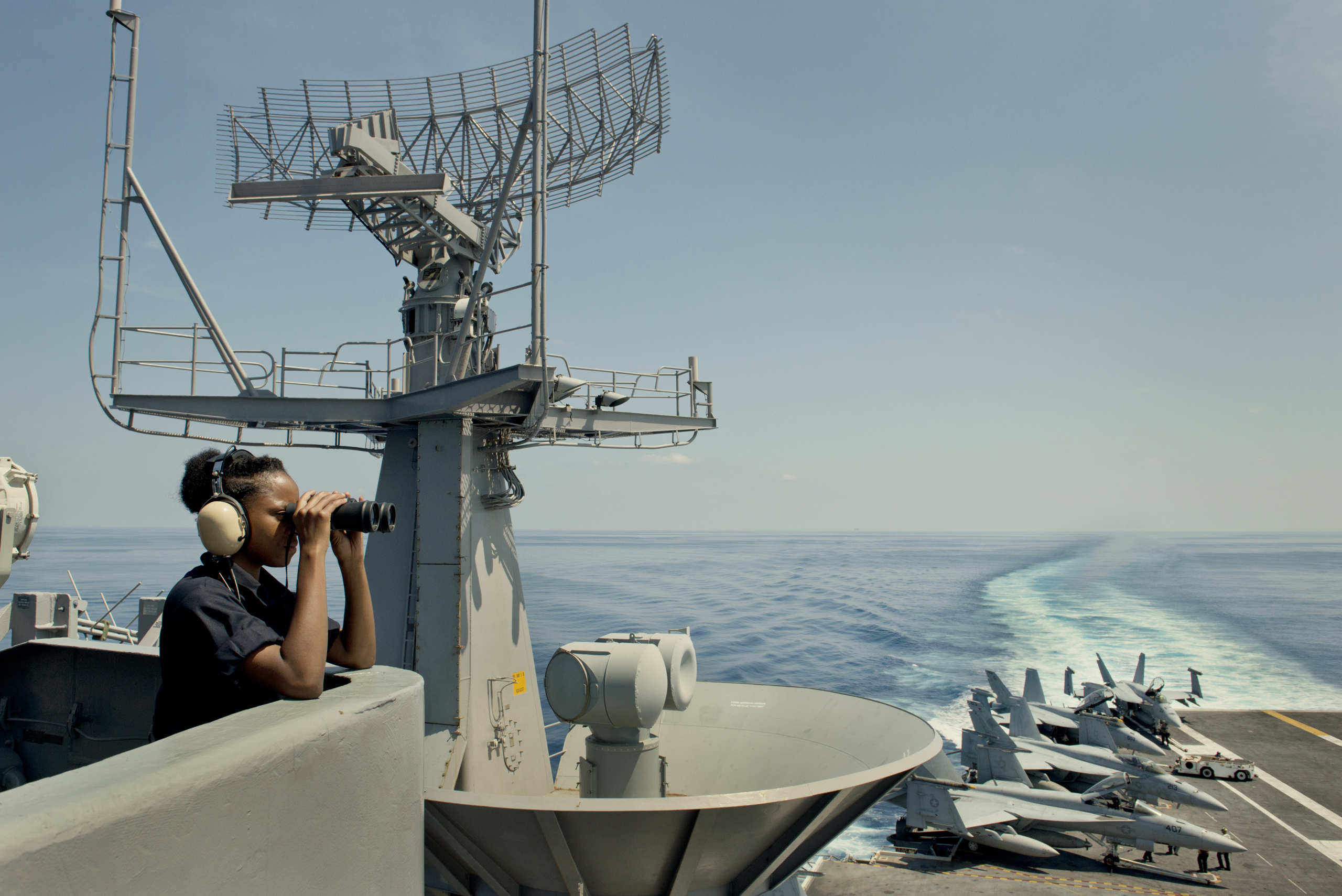 A lookout watches on the bridge of the U.S.S. John C. Stennis aircraft carrier in the South China Sea on April 25, 2016