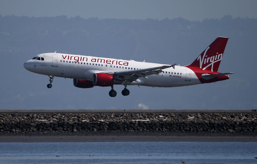 A Virgin America plane lands at San Francisco International Airport on March 29, 2016 in Burlingame, California.