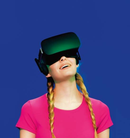 A young woman wearing Oculus Rift virtual reality goggles