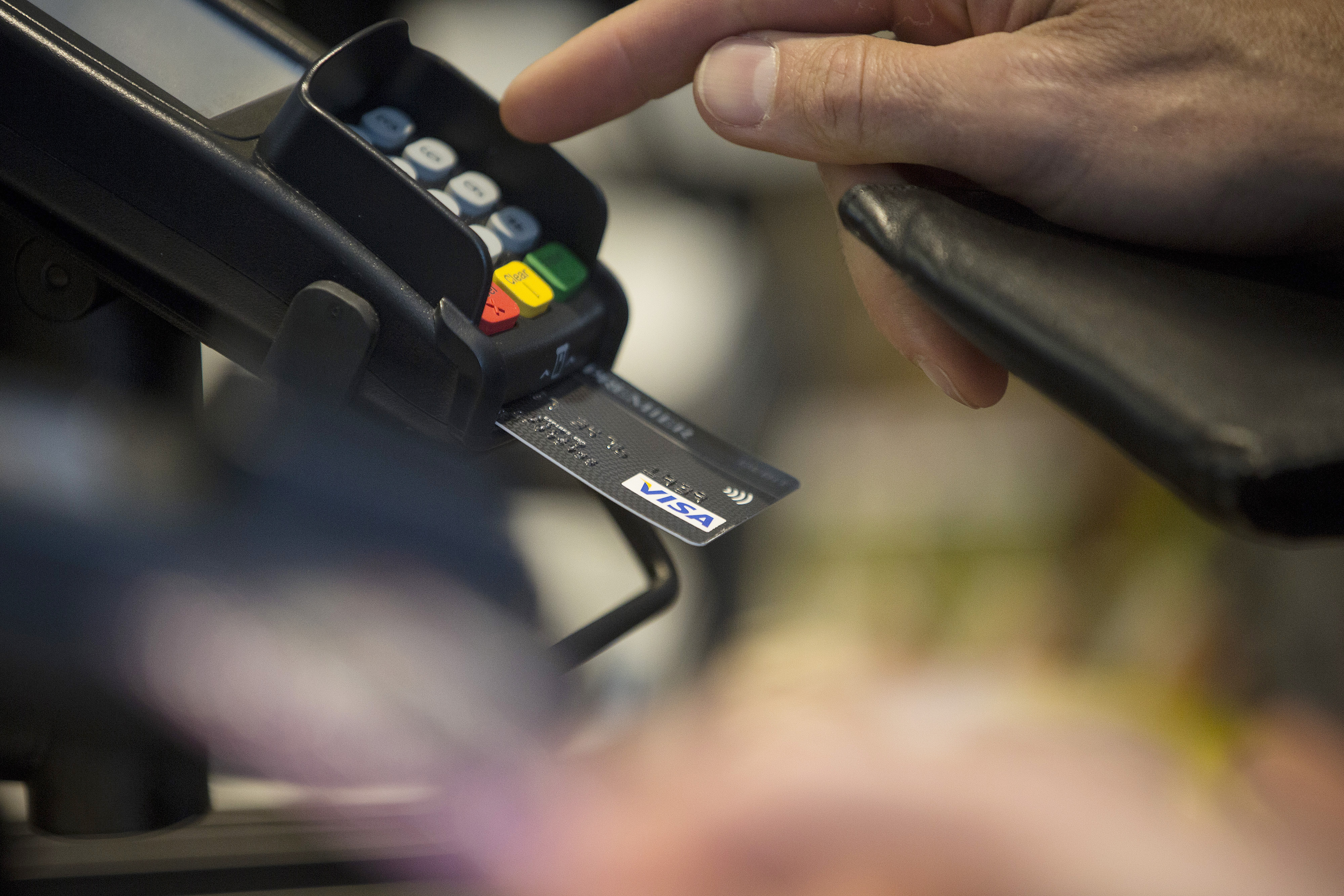 A customer enters their pin number while making a chip and pin payment using a Visa Inc. payment card.