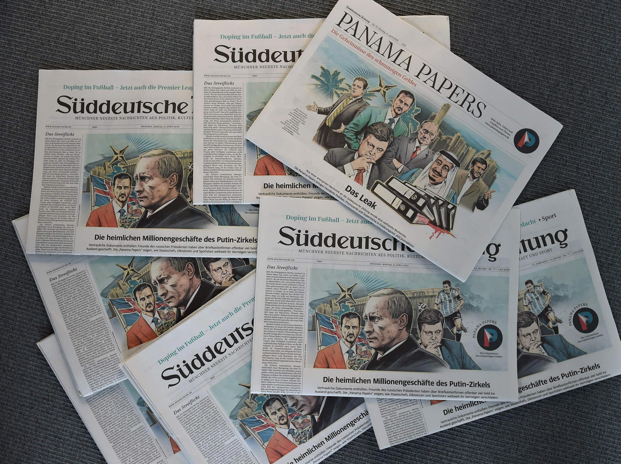 Issues of the German daily Sueddeutsche Zeitung, featuring illustrations of leaders including Russian President Vladimir Putin by Peter M Hoffmann, are seen at the newspaper's office in Munich, Germany, April 7, 2016.