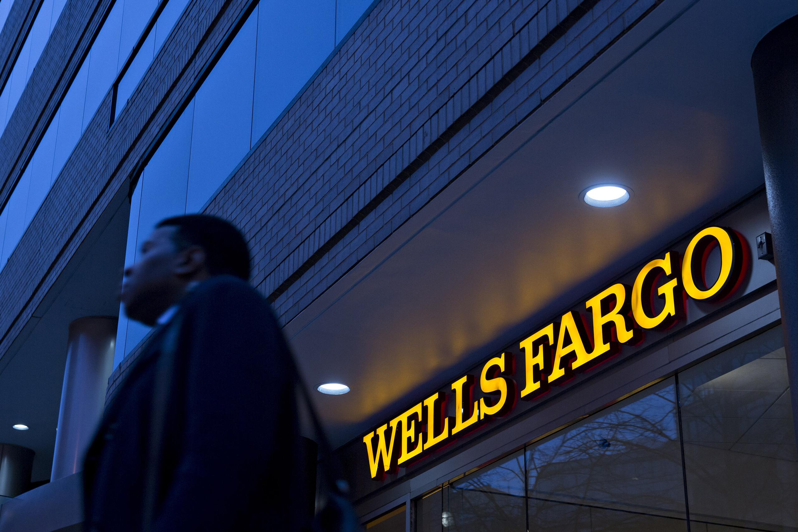 A pedestrian walks past a Wells Fargo & Co. bank branch in Washington on Jan. 7, 2016.